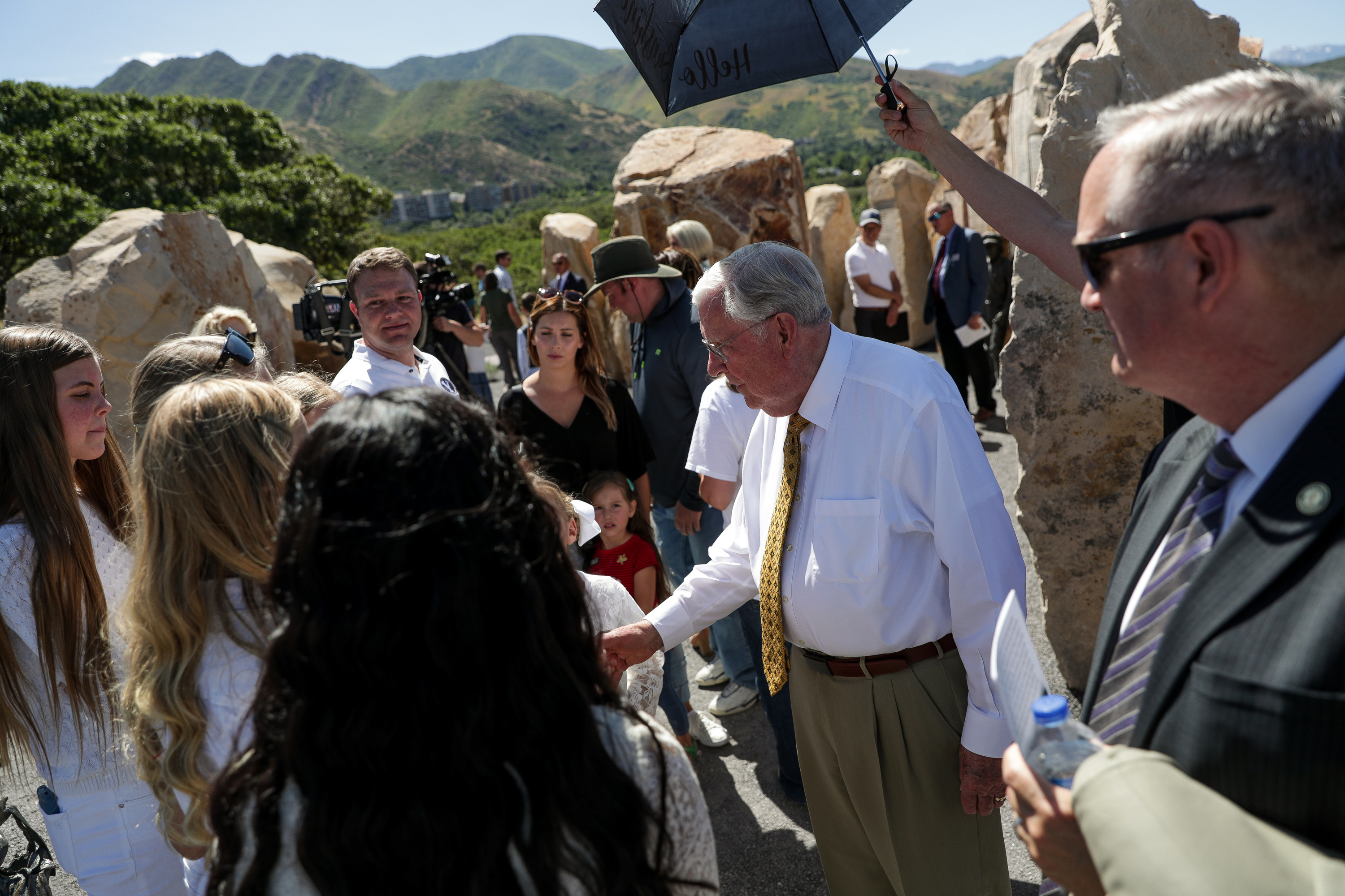 President M. Russell Ballard, acting president of the Quorum of the Twelve Apostles of The Church of Jesus Christ of Latter-day Saints, greets people after the dedication of the Children's Pioneer Memorial at This Is the Place Heritage Park in Salt Lake City on Saturday, July 20, 2019.