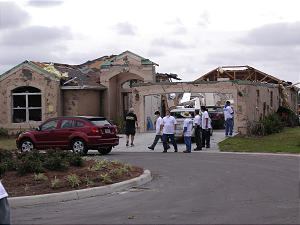 Latter-day Saint volunteers work outside the Myrna and Valentino Cucolo home in The Villages, a community in Lady Lake, Fla., devastated by tornadoes Feb. 2.