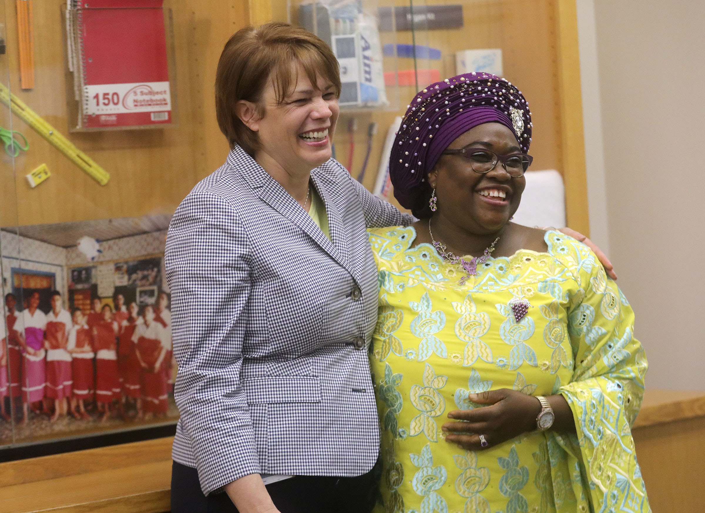 Sister Sharon Eubank, first counselor in the Relief Society general presidency, hugs Mariama Kallon-Olayemi, guest speaker, after Kallon-Olayemi shared her experience of receiving a donated sanitary kit during a tour for spouses of U.S. governors at the Latter-day Saint Humanitarian Center in Salt Lake City on Thursday, July 25, 2019.