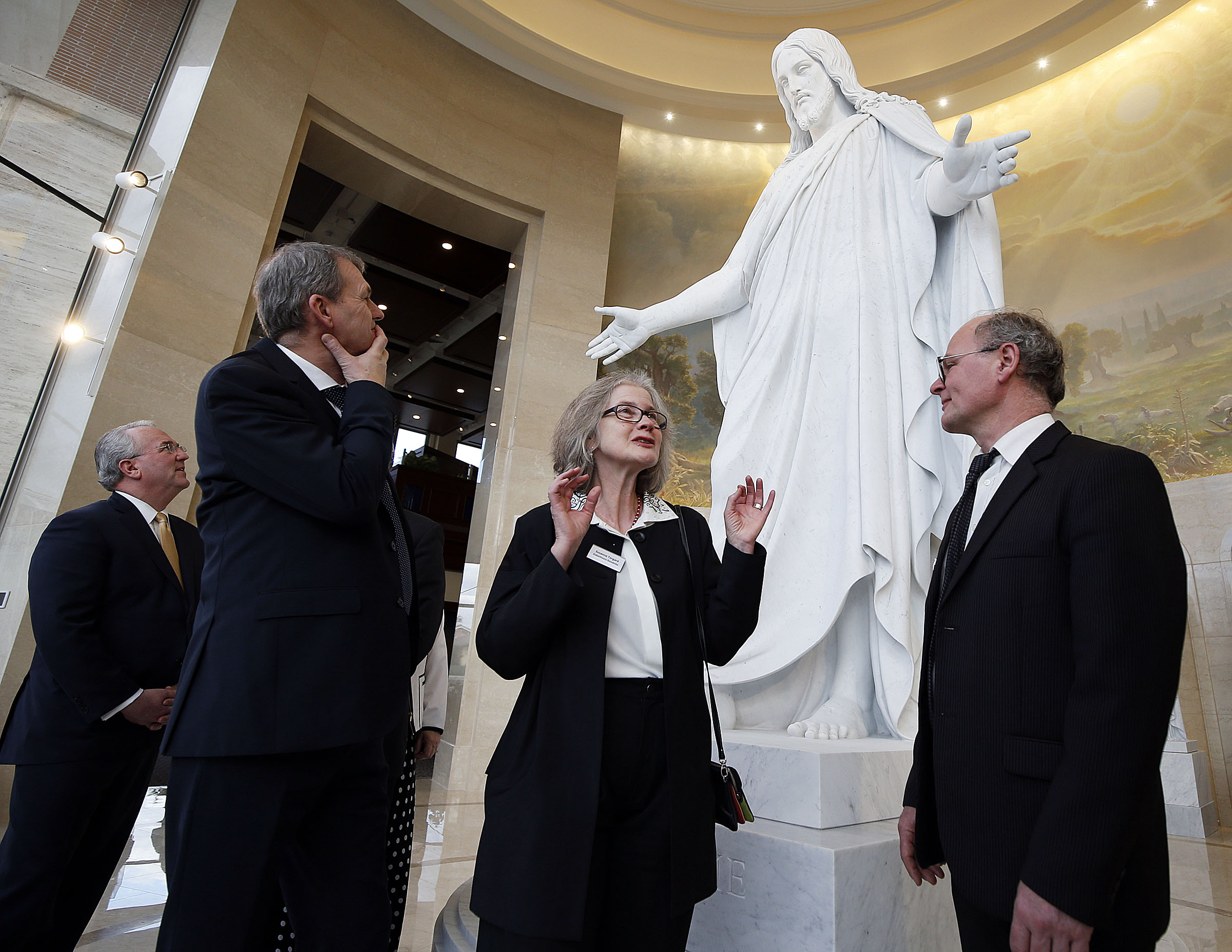 Susanne Torgard, curator at the Church of Our Lady in Copenhagen, Denmark, home of the original Christus statue, stands at the base of the digital, 3-D replica done in marble at the Rome Italy Temple and talks about it with Elder Jack N. Gerard, far left, of The Church of Jesus Christ of Latter-day Saints, and her colleagues at the Church of Our Lady, Bent Sloth, facility director, and on the right, Steffen Ringgaard Andresen, vicar priest in Rome, Italy, on Wednesday, Jan. 16, 2019.