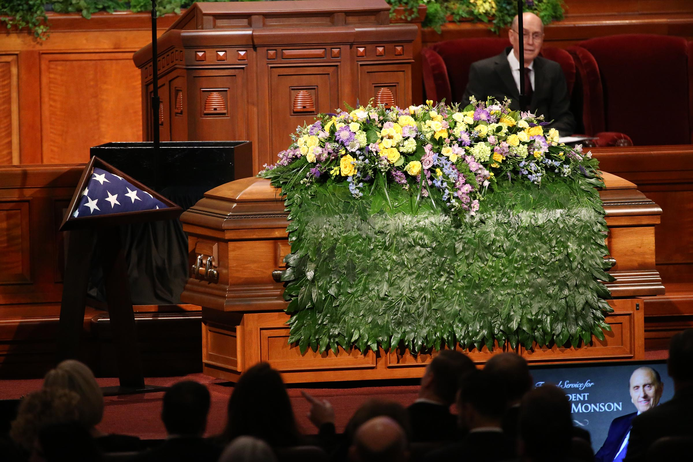 President Thomas S. Monson's casket is draped with flowers before the start of his funeral at the Conference Center in Salt Lake City on Friday, Jan. 12, 2018.