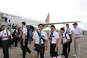 Missionaries, evacuated after Typhoon Haiyan in 2013, are pictured returning to Tacloban in the Philippines. Per a government mandate on March 17, 2020, all nonnative missionaries in the Philippines are being moved out of the country.