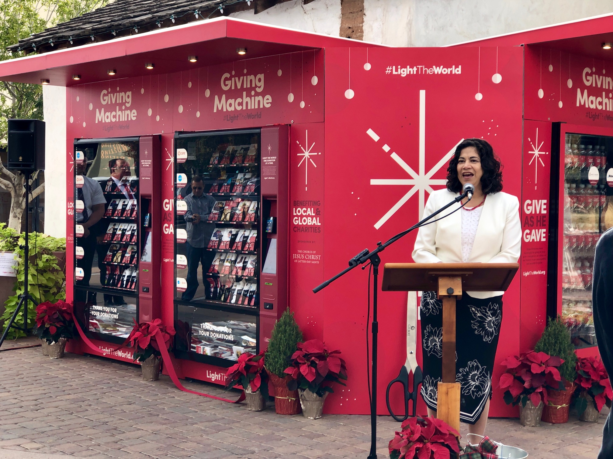 """Sister Reyna I. Aburto, second counselor in the Relief Society general presidency, spoke to a group of media and local leaders. """"Jesus Christ is the light of the world and when we help others we are sharing His light with the people around us."""" The giving machines, part of the Church's popular #LightTheWorld campaign, opened in Gilbert, Arizona, on Thursday, Nov. 29."""