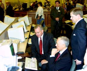Elder D. Todd Christofferson, left, accompanies Sen. Orrin Hatch, center, during the lawmaker's visit to the Church's Family History Library. At right is library's director, David Rencher.