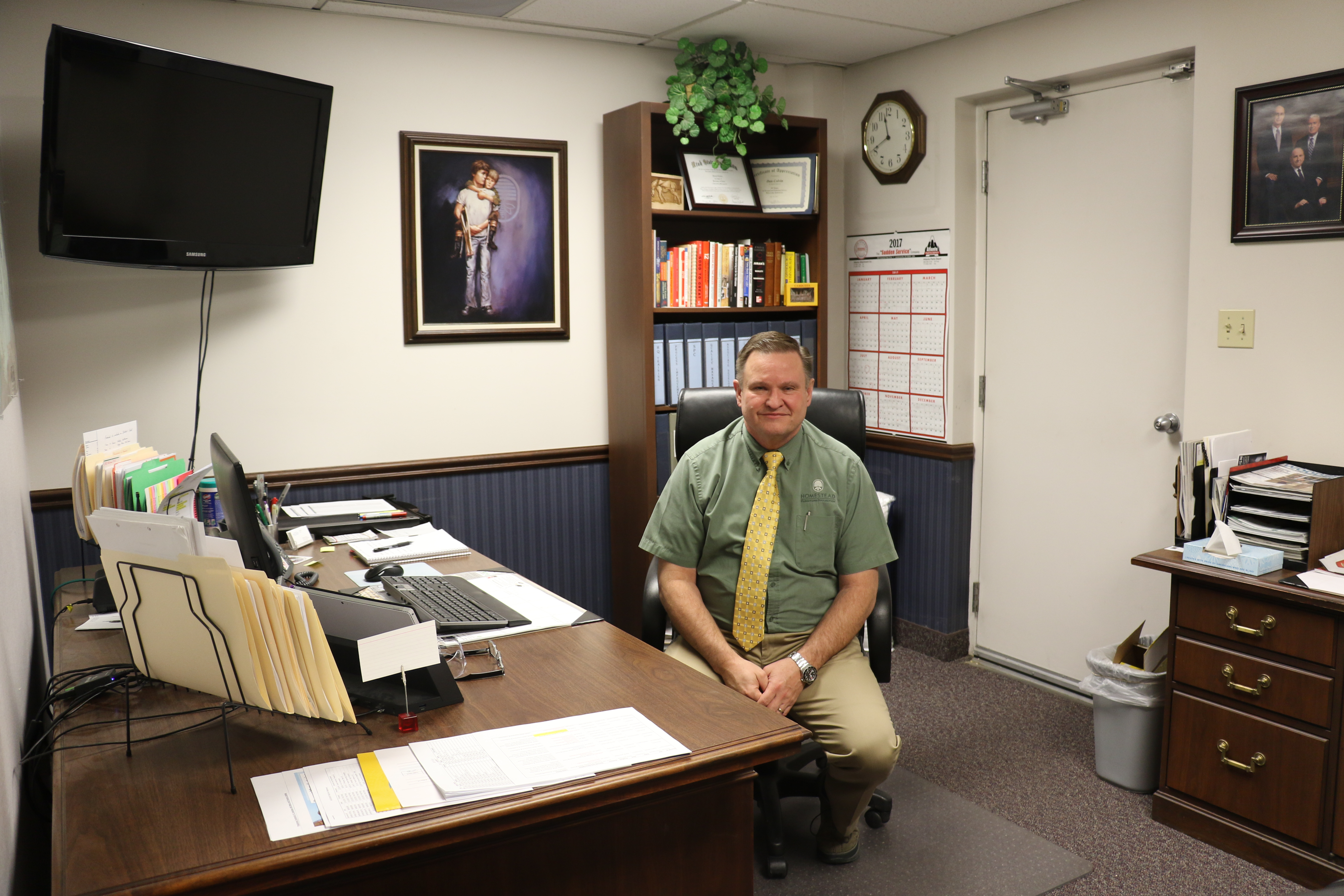 Dan Colvin, Welfare processing facility manager, sits in his office in the Deseret Manufacturing facility in Salt Lake City, Utah.