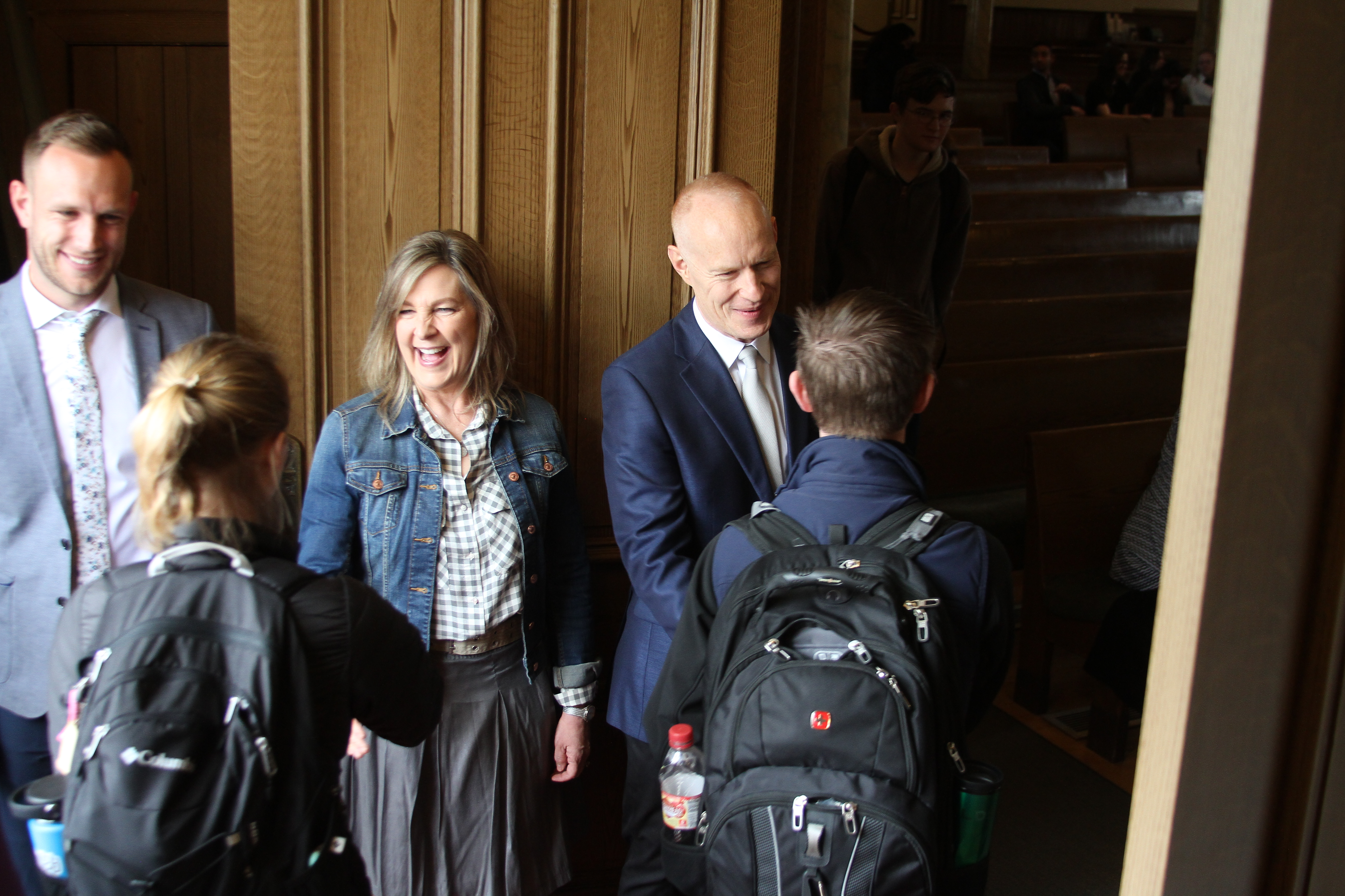Michelle and Jon Schmidt greet LDS Business College students as they enter the Assembly Hall on Temple Square on March 26, 2019.