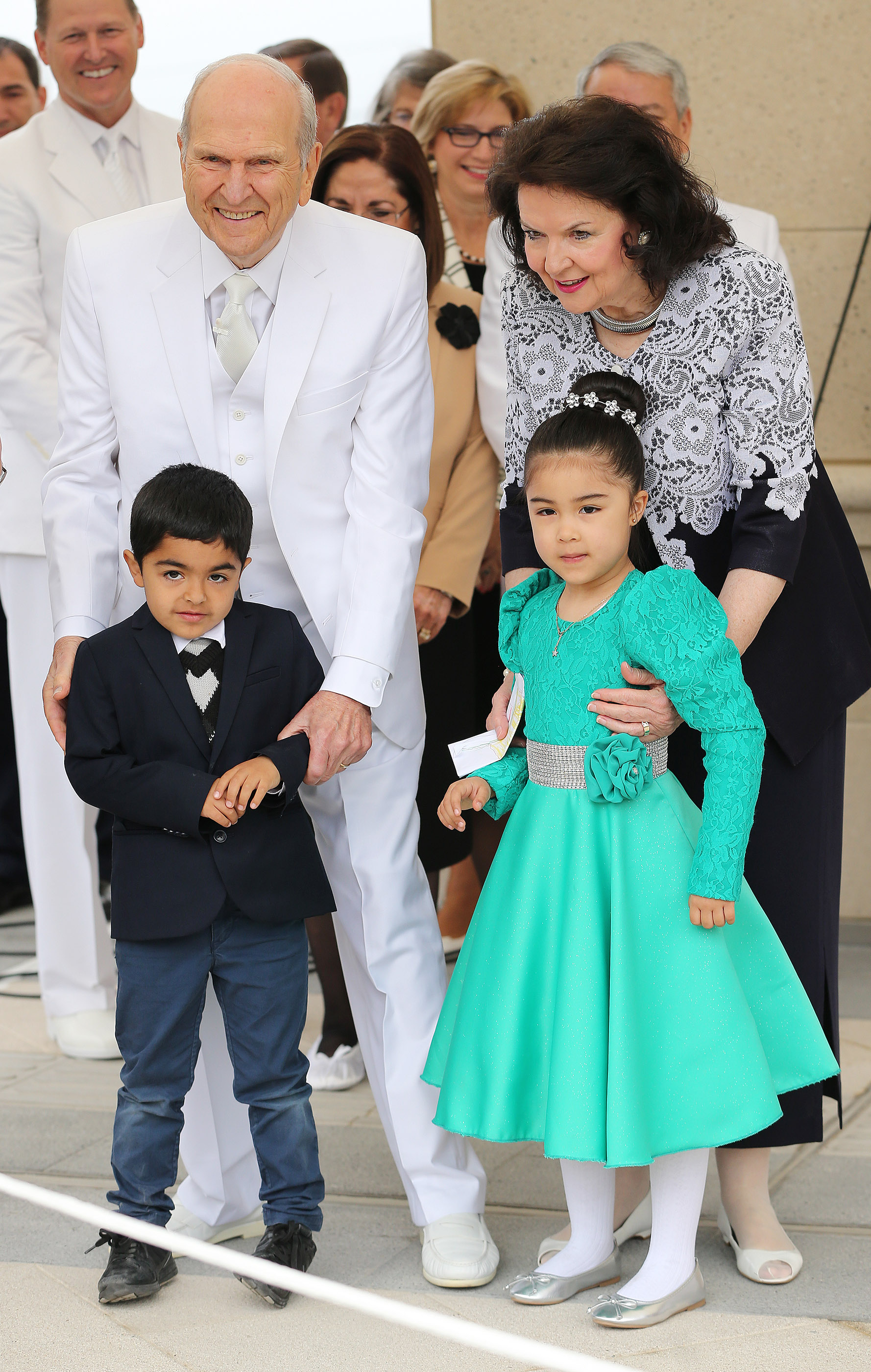 President Russell M. Nelson of The Church of Jesus Christ of Latter-day Saints and his wife, Sister Wendy Nelson, stand with attendees Augustine Escobar and Lilieth Rojas during the cornerstone ceremony of the Concepcion Chile Temple in Concepcion, Chile, on Sunday, Oct. 28, 2018.