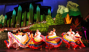 "Women in decorative skirts perform Venezuelan folk dance during the ""Luz de las Naciones"" cultural event at the Conference Center. The program celebrated the rich cultures of Latin America and the Pacific Islands and included a cast of thousands."