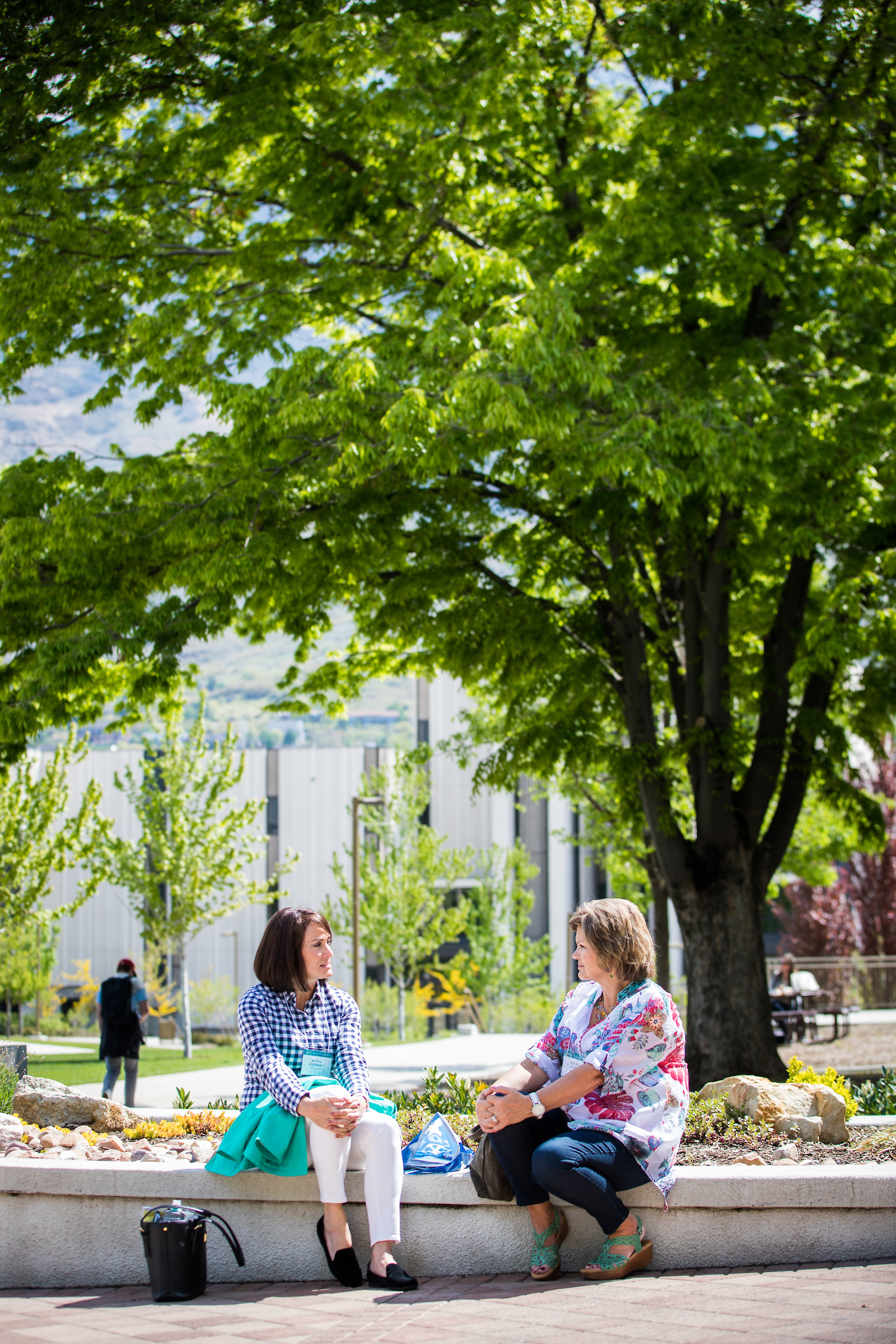 Attendees take a break on the BYU campus in Provo, Utah, during the annual BYU Women's Conference held May 3-4, 2018.