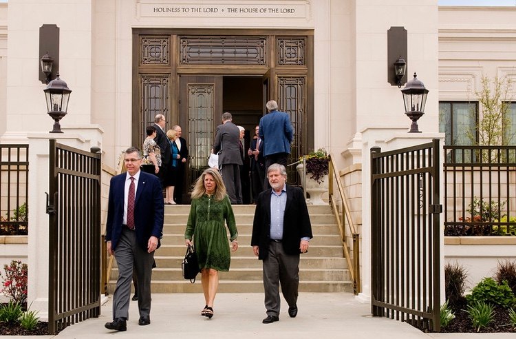 Visitors from the specially invited guest tour of the Memphis Tennessee Temple during the open house as they exit the temple on a sunny day in April 2019.
