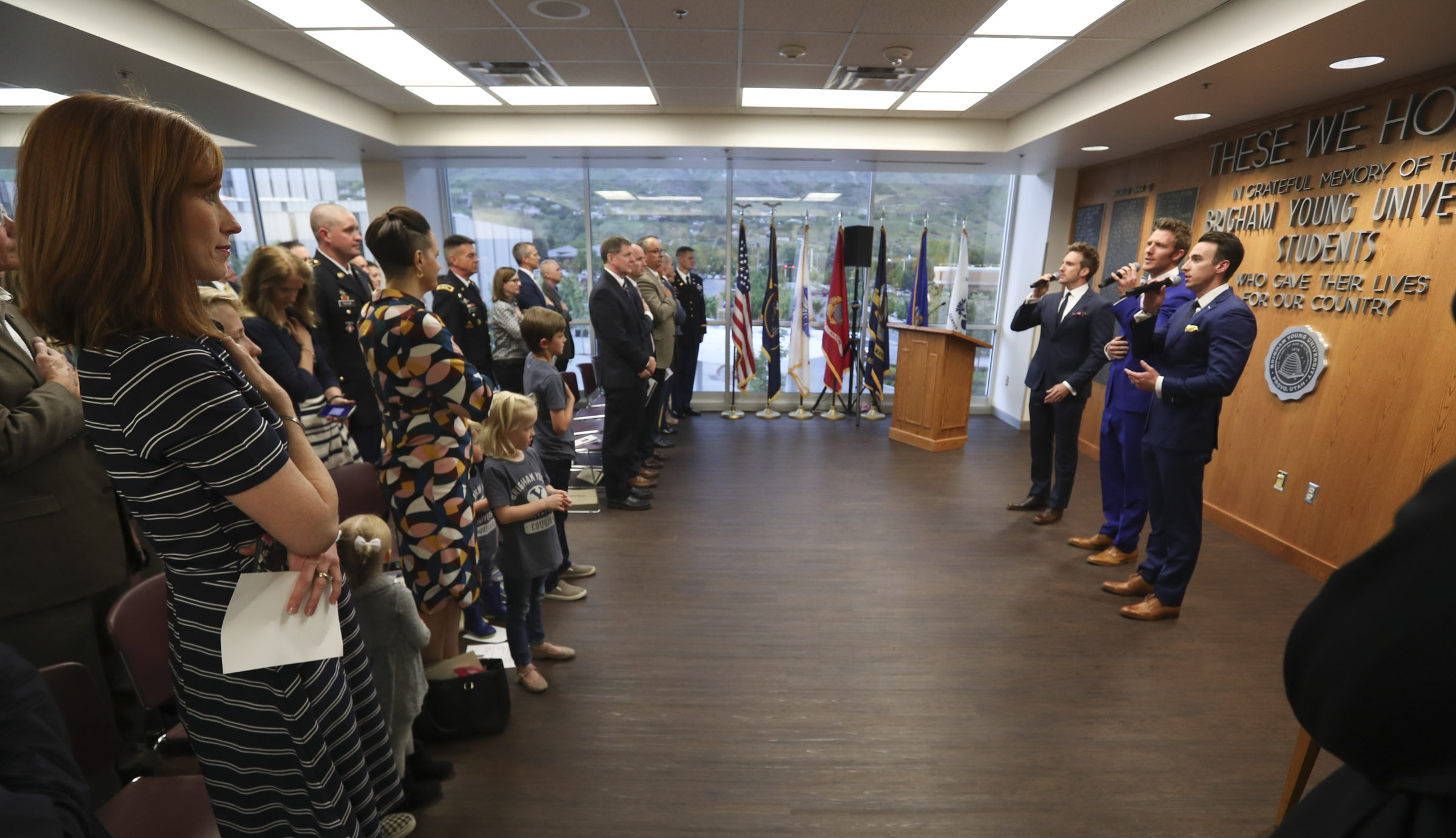 Jennie Taylor stands with her children as the group Gentri sings the National Anthem during a ceremony where the name of her late husband, Maj. Brent Taylor, was added to the Reflection Room Memorial Wall in the Wilkinson Center on the BYU campus in Provo on Thursday, May 23, 2019. Taylor was killed in Afghanistan in 2018.