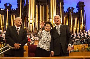 President Dieter F. Uchtdorf and Sister Harriet Uchtdorf stand with Robert H. Garff, President of the Bountiful Utah Temple Sunday, Feb. 9, 2014 during a devotional for workers at that temple, inside the Tabernacle on Temple Square.