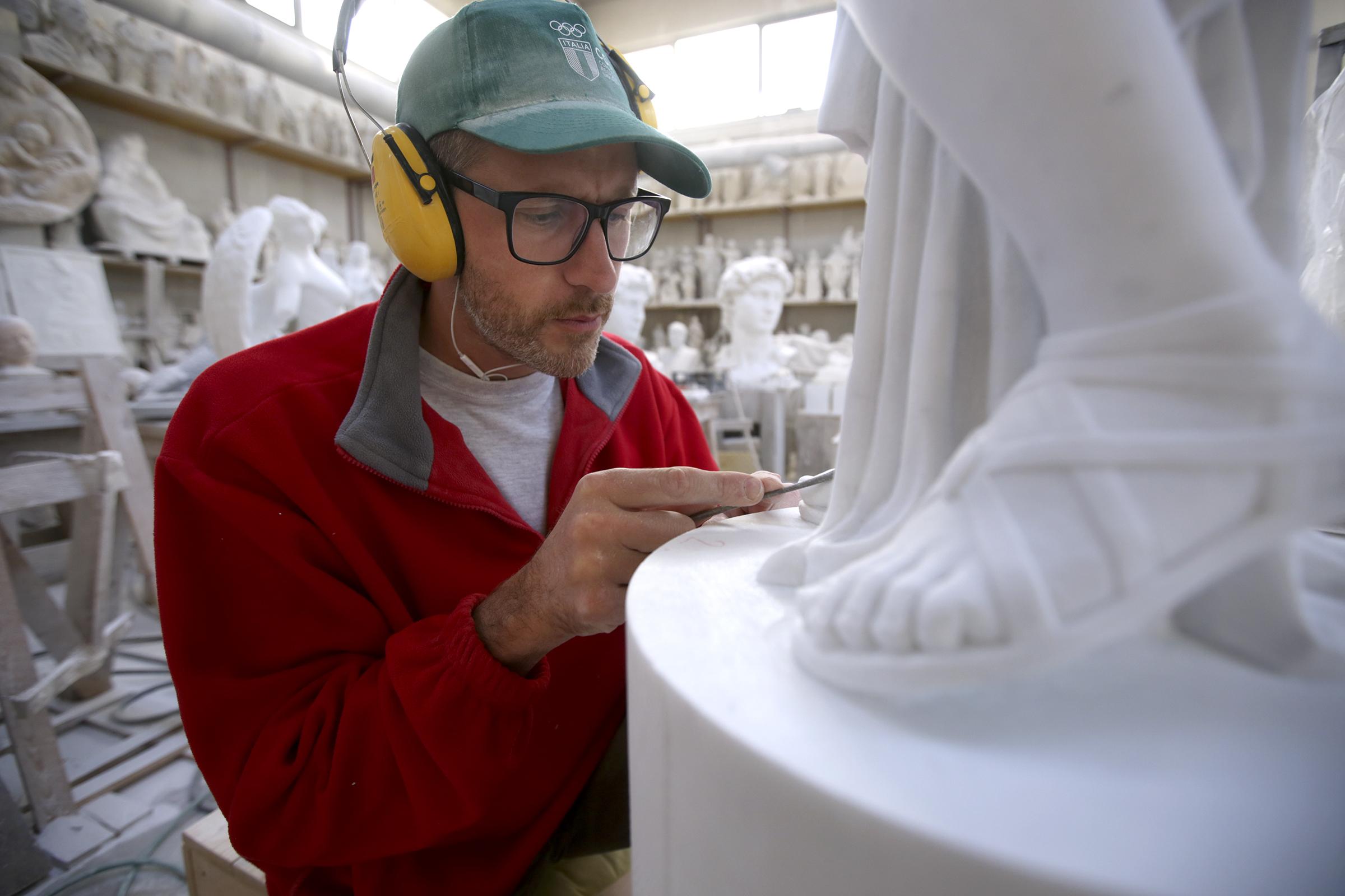 Johannes Felder sculpts a marble statue at the Studi d'Arte Cave Michelangelo in Carrara, Italy, on Thursday, Nov. 15, 2018.