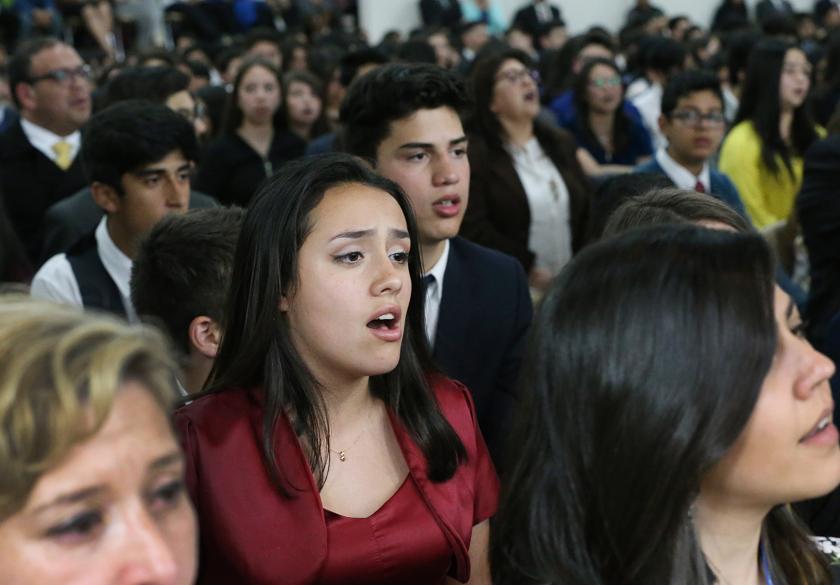 Attendees sing during a youth devotional in Concepción, Chile, on Saturday, Oct. 27, 2018.