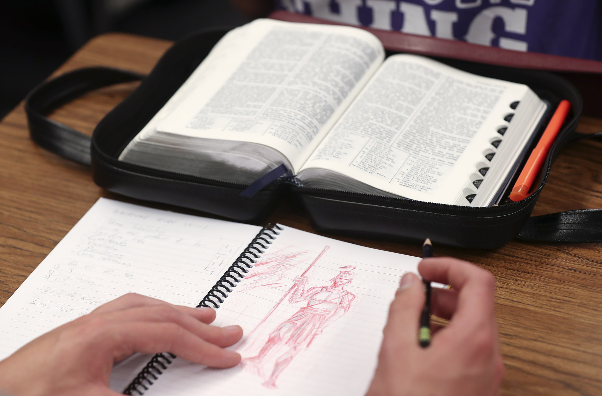 A student prepares to write in his journal during an LDS seminary class at West High School in Salt Lake City on Monday, Sept. 17, 2018.