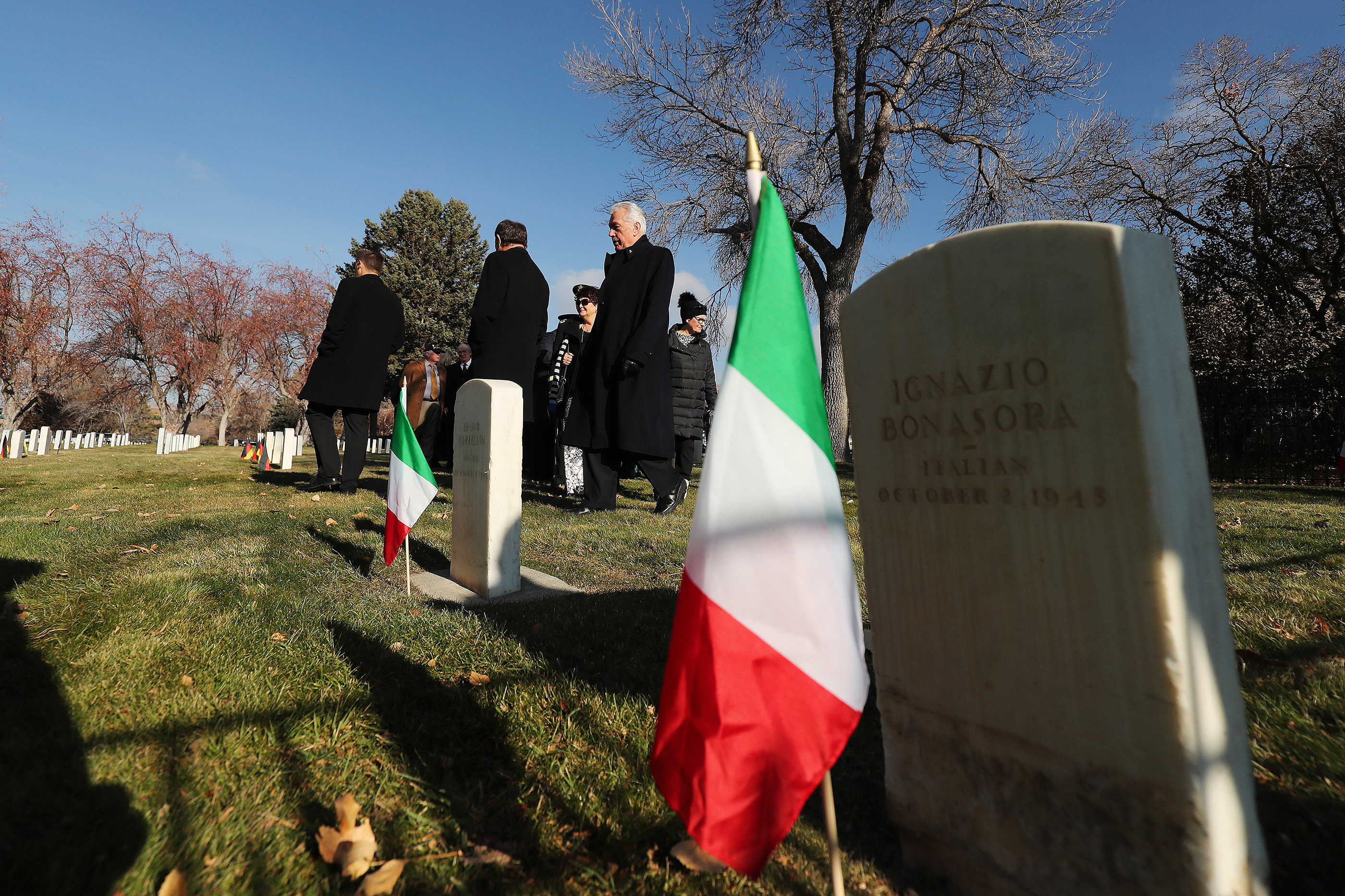 Gov.Gary Herbert and Elder Dieter F. Uchtdorf of The Church of Jesus Christ of Latter-day Saints' Quorum of the Twelve Apostles, walks through graves during the German Day of Remembrance (Volkstrauertag) at Fort Douglas Military Cemetery in Salt Lake City on Sunday, Nov. 18, 2018.