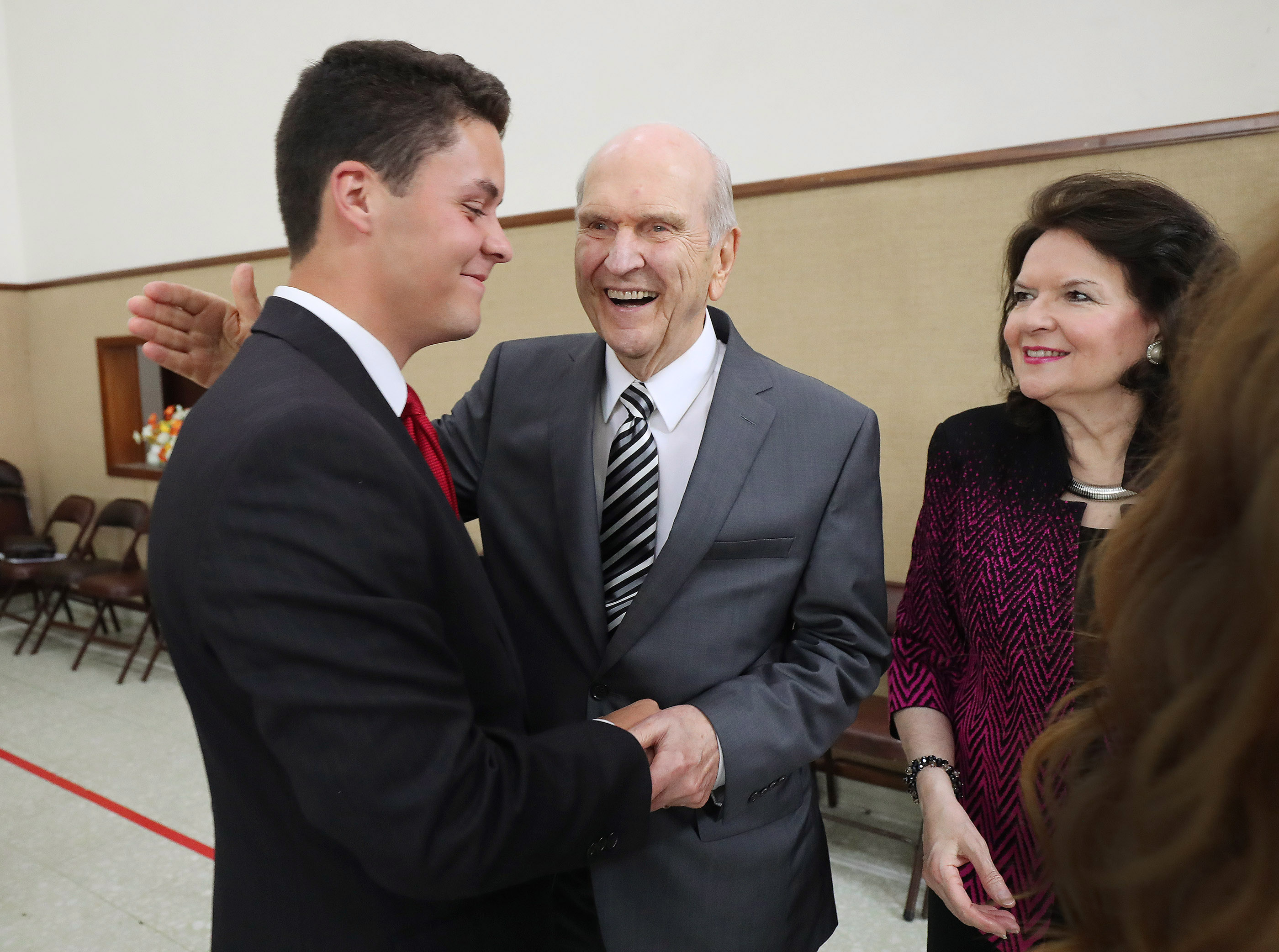President Russell M. Nelson of The Church of Jesus Christ of Latter-day Saints, and his wife, Sister Wendy Nelson, greet their grandson Elder Nicholas Nelson, a missionary serving in the Uruguay Montevideo West Mission, prior to a missionary meeting in Montevideo, Uruguay, on Thursday, Oct. 25, 2018.