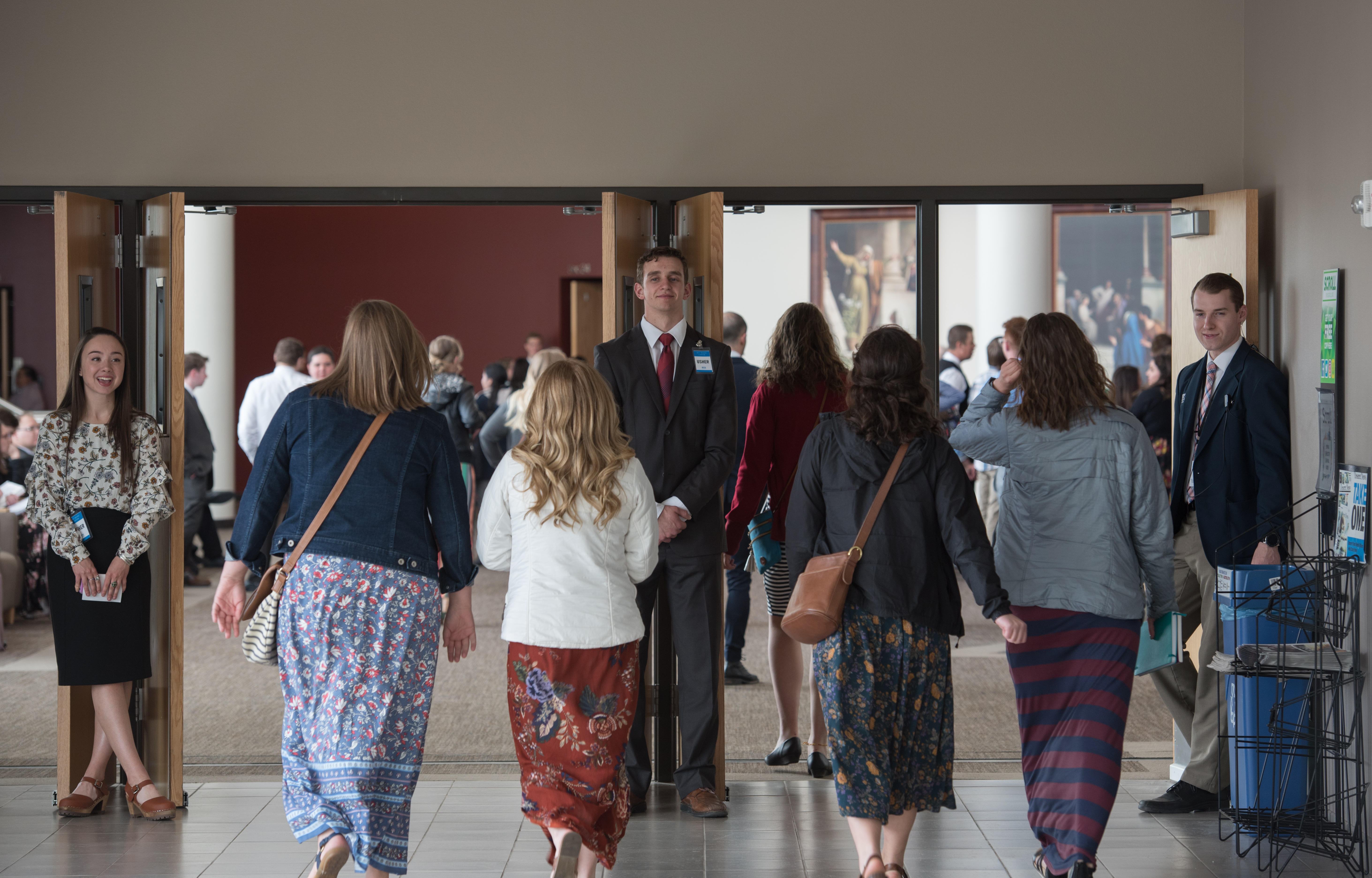 Students arrive at the BYU-Idaho Center to hear Elder Ronald A. Rasband and his wife, Sister Melanie Rasband, speak during a devotional on April 28, 2019.