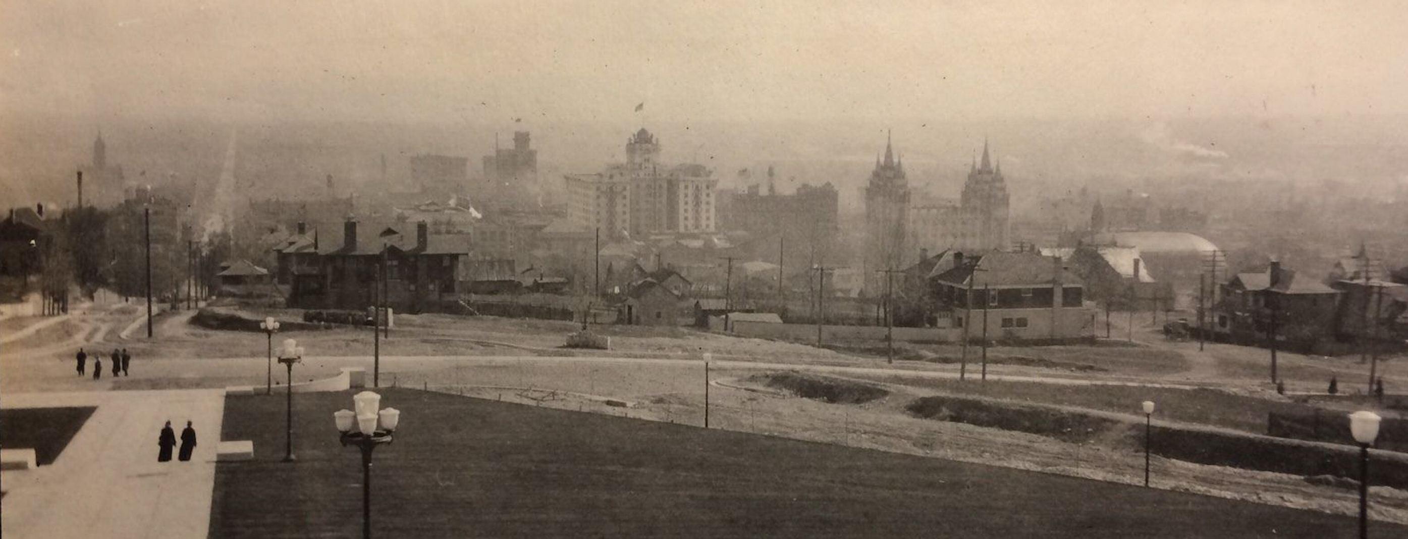 A view of the Salt Lake Valley from the steps of the Utah State Capitol on April 6, 1917. The view includes the Hotel Utah, center, the Salt Lake Temple, and the Salt Lake Tabernacle.