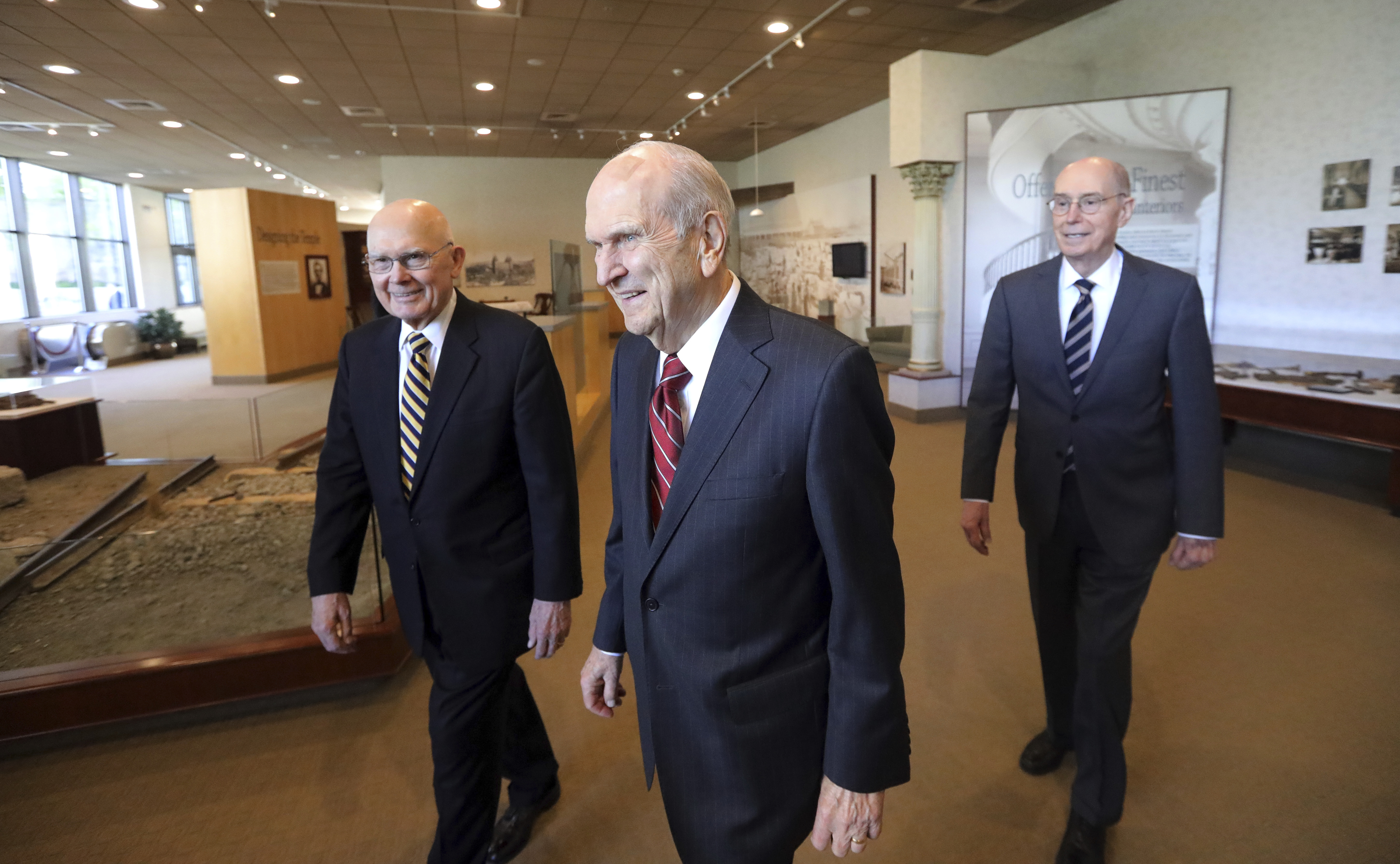 The Church of Jesus Christ of Latter-day Saints President Russell M. Nelson, center, walks with his counselors, Dallin H. Oaks, left, and Henry B. Eyring, right, as they arrive for a news conference at the Temple Square South Visitors Center Friday, April 19, 2019, in Salt Lake City. An iconic temple central to The Church of Jesus Christ of Latter-day Saints faith will close for four years to complete a major renovation, and officials are keeping a careful eye on construction plans after a devastating fire at Notre Dame cathedral in Paris. Nelson said the closure will begin in December. (AP Photo/Rick Bowmer)