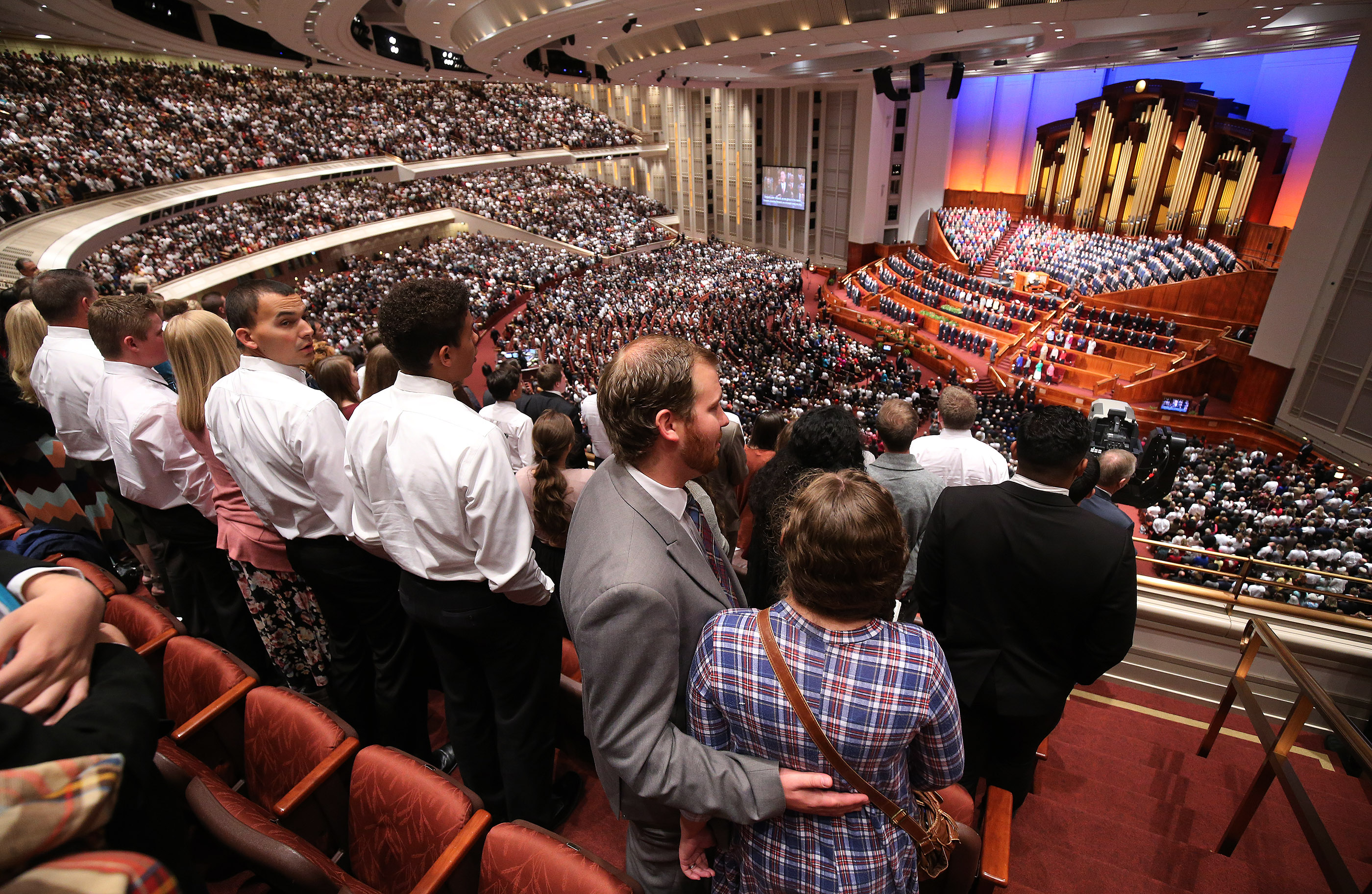 Attendees sing a congregational hymn during the Saturday afternoon session of the 188th Semiannual General Conference of The Church of Jesus Christ of Latter-day Saints in the Conference Center in Salt Lake City on Saturday, Oct. 6, 2018.