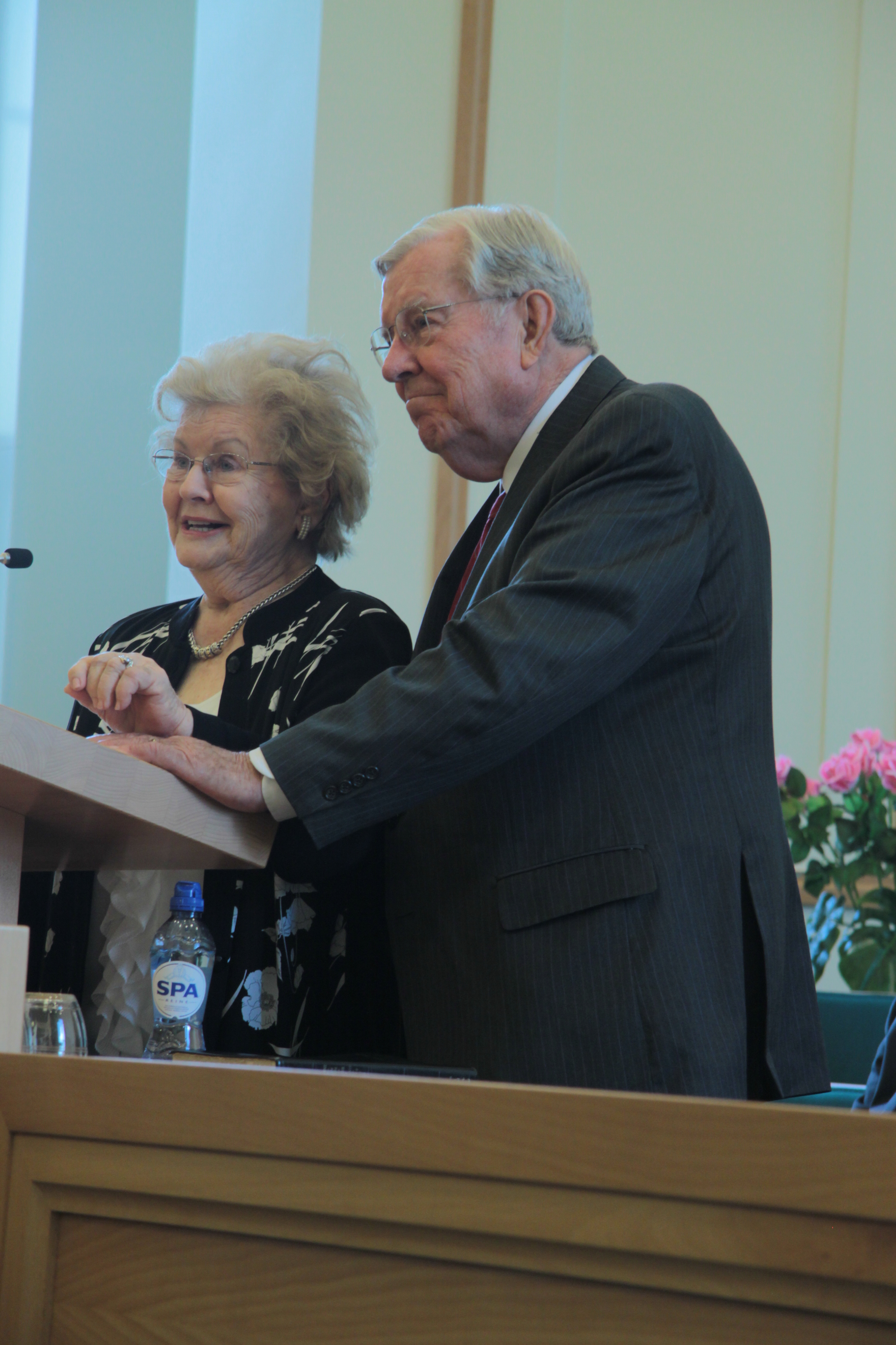 Sister Barbara B. Ballard joins her husband, Elder M. Russell Ballard, at the pulpit during a member meeting in Netherlands in September 2014.