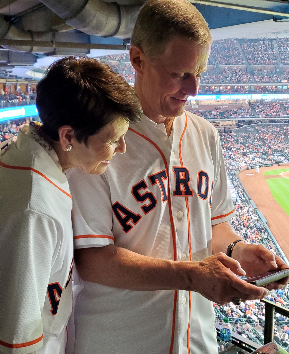 Sister Susan Bednar and Elder David A. Bednar watch the video of his ceremonial first pitch delivered at Minute Maid park.