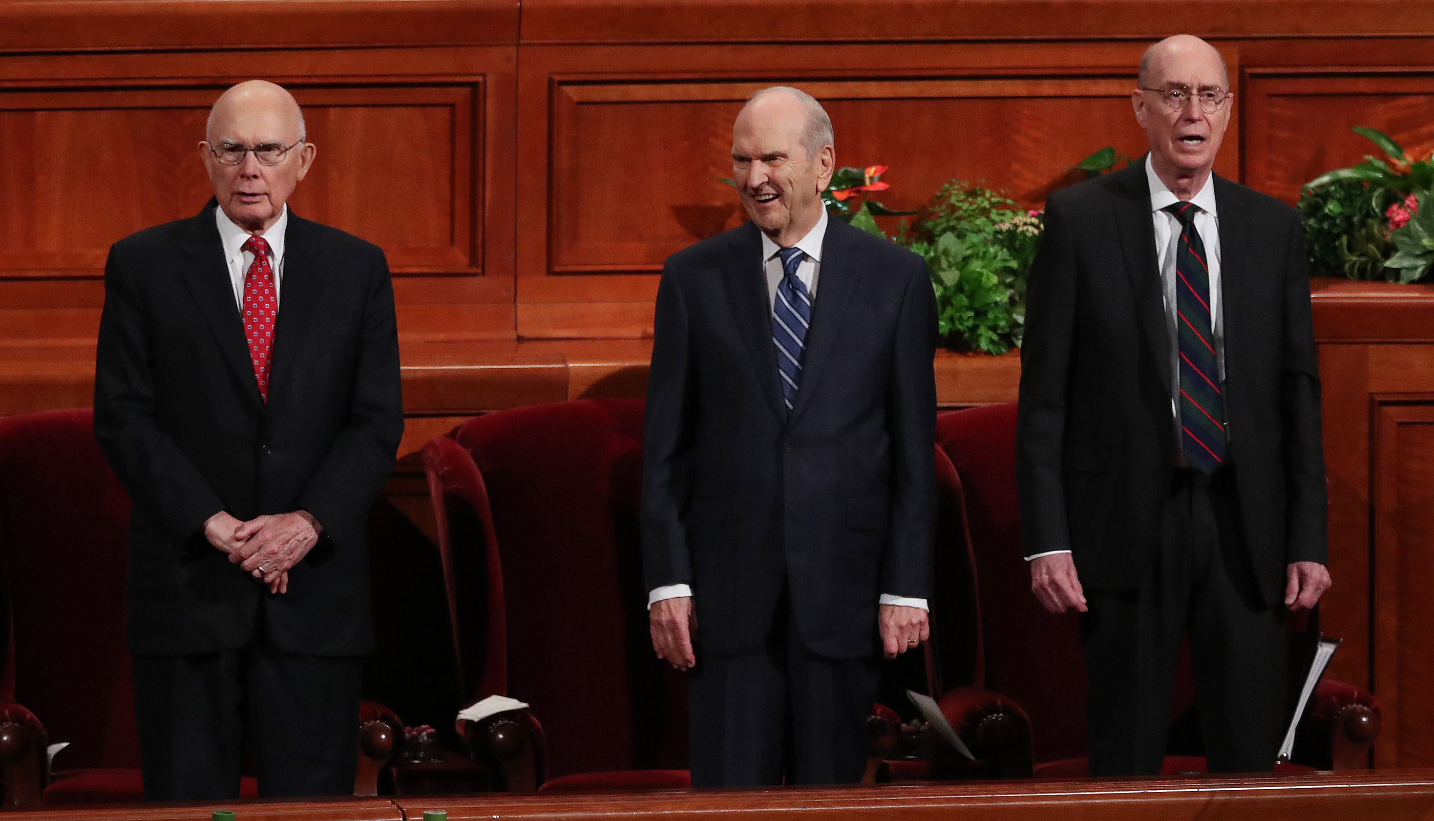 President Russell M. Nelson of The Church of Jesus Christ of Latter-day Saints, center, and his counselors, President Dallin H. Oaks, first counselor in the First Presidency, left, and President Henry B. Eyring, second counselor in the First Presidency, right, sing a congregational hymn during the 188th Semiannual General Conference of The Church of Jesus Christ of Latter-day Saints in Salt Lake City on Sunday, Oct. 7, 2018.