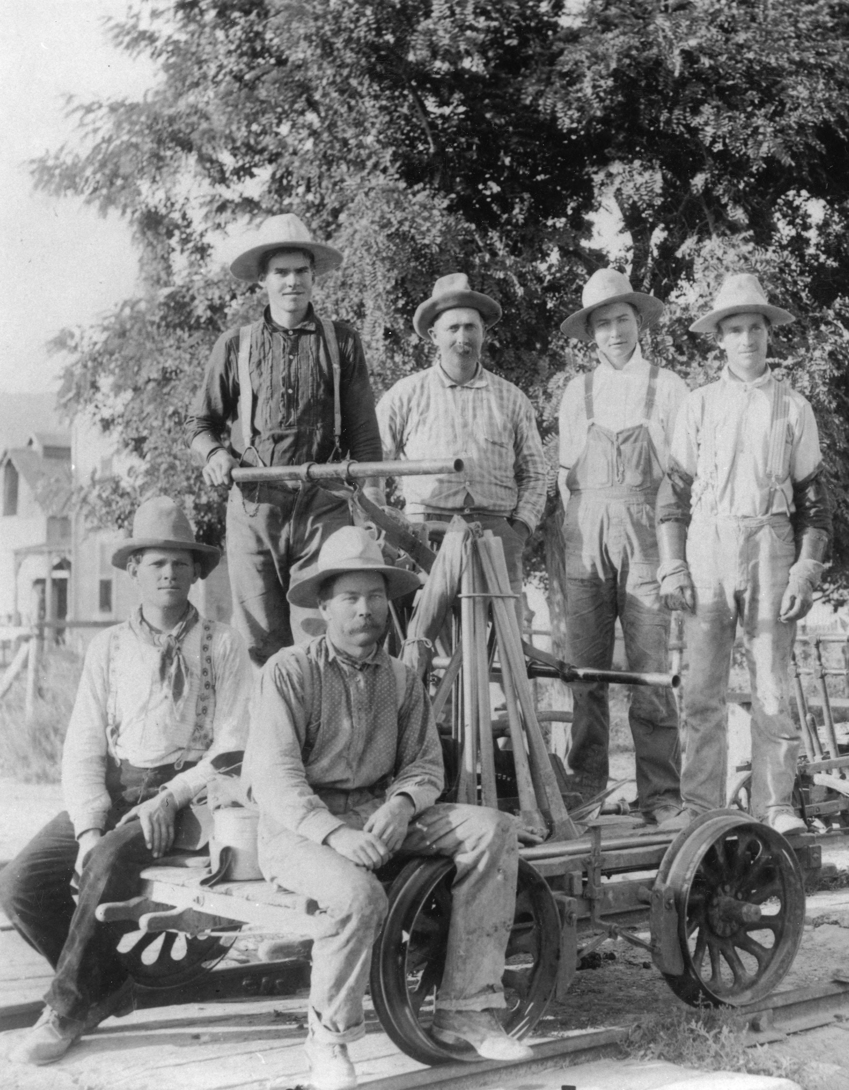 Railroad car and maintenance crew.