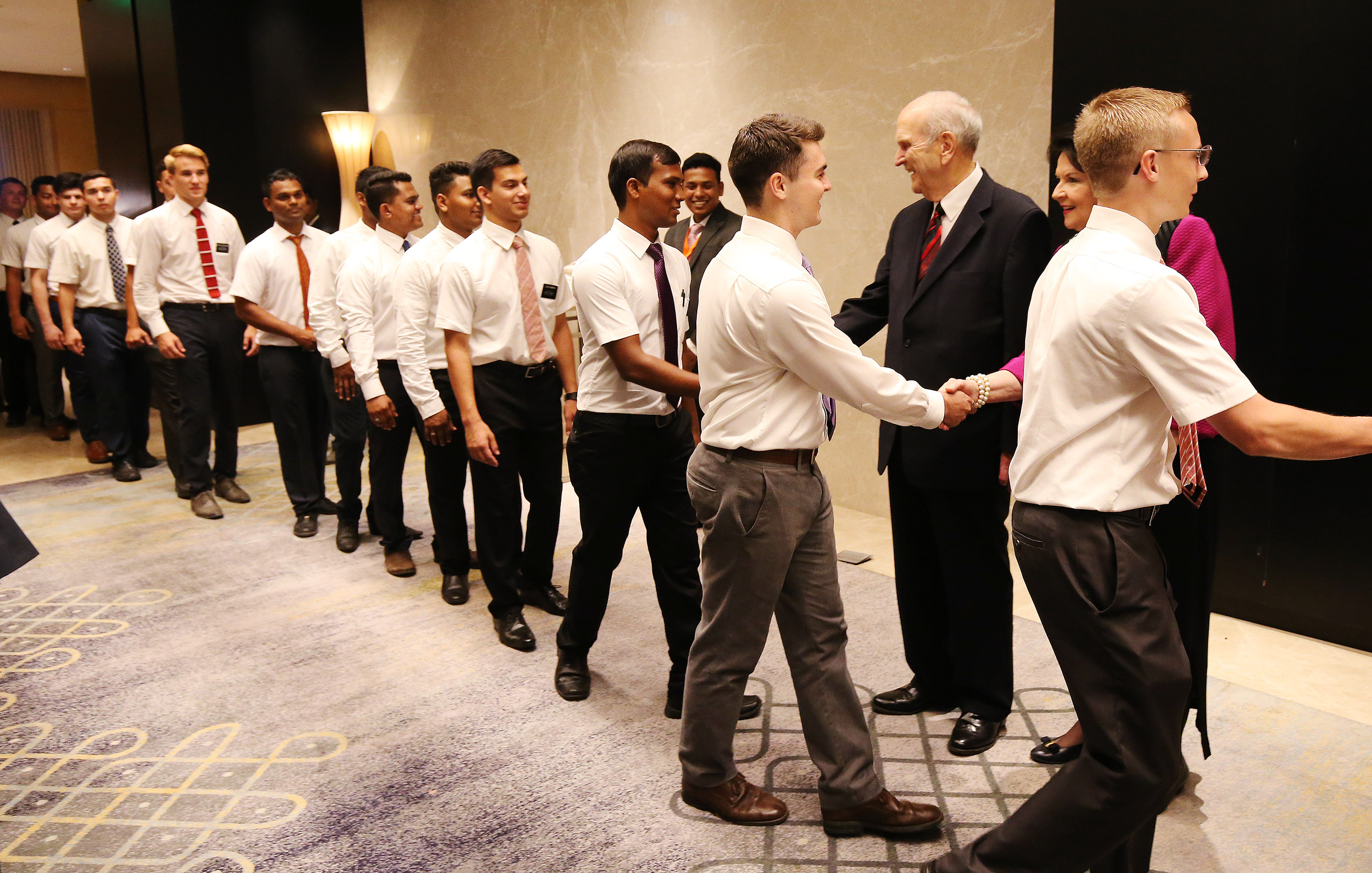 President Russell M. Nelson greets missionaries prior to a conference in Bengaluru, India, on Thursday, April 19, 2018.