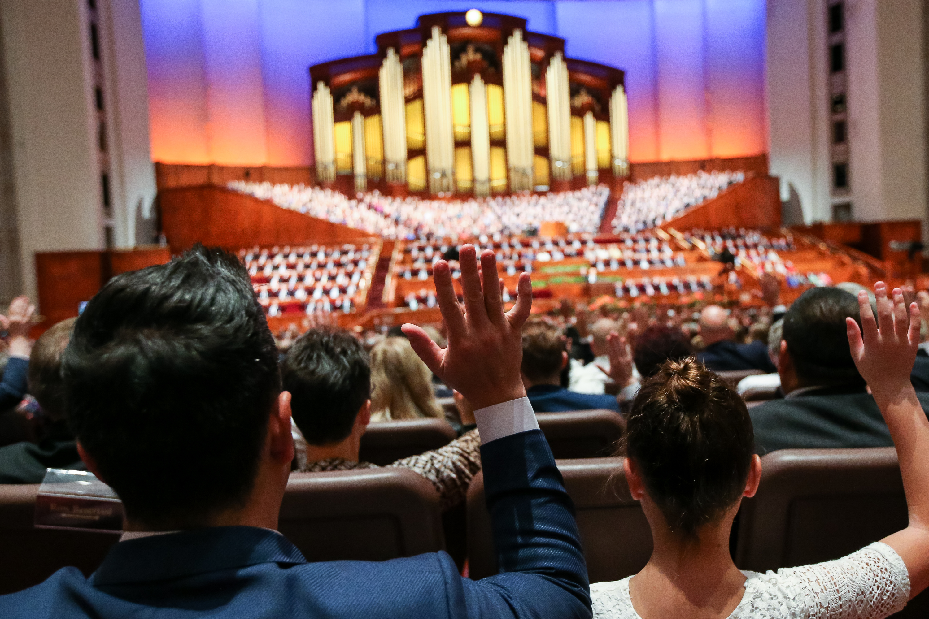Conferencegoers raise their hands to sustain church leaders during the Saturday afternoon session of the 188th Semiannual General Conference of The Church of Jesus Christ of Latter-day Saints in the Conference Center in Salt Lake City on Saturday, Oct. 6, 2018.