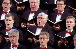 The Tabernacle Choir sings during The First Presidency Christmas Devotional at the Conference Center, Sunday, December 2, 2001.
