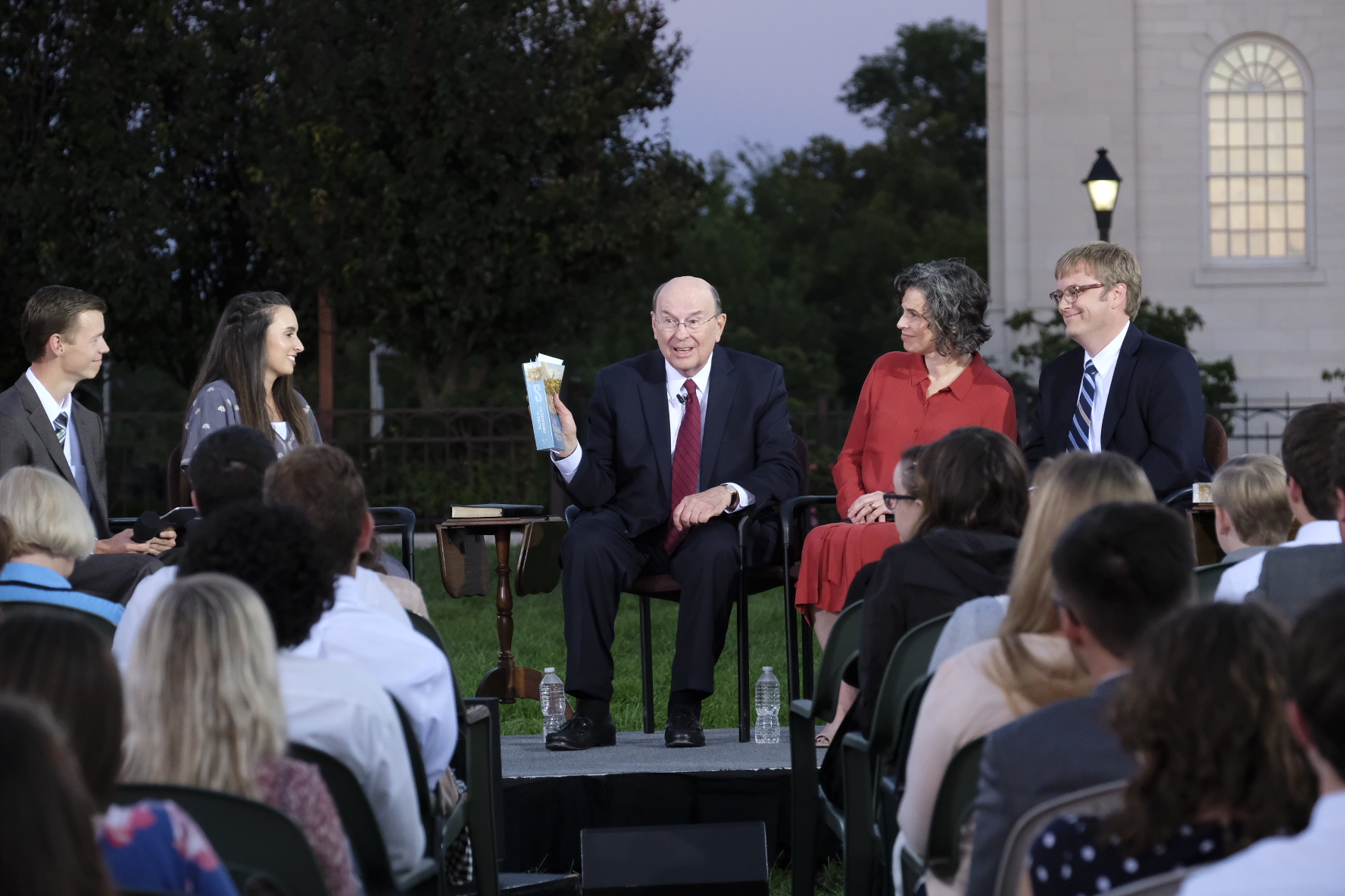 """Elder Quentin L. Cook of the Quorum of the Twelve Apostles, center, addresses young adults ages 18 to 30 during a worldwide """"Face to Face"""" broadcast focusing on the history of the Church. Also participating were Church historians Kate Holbrook and Matt Grow in the Sept. 9, 2018 event."""