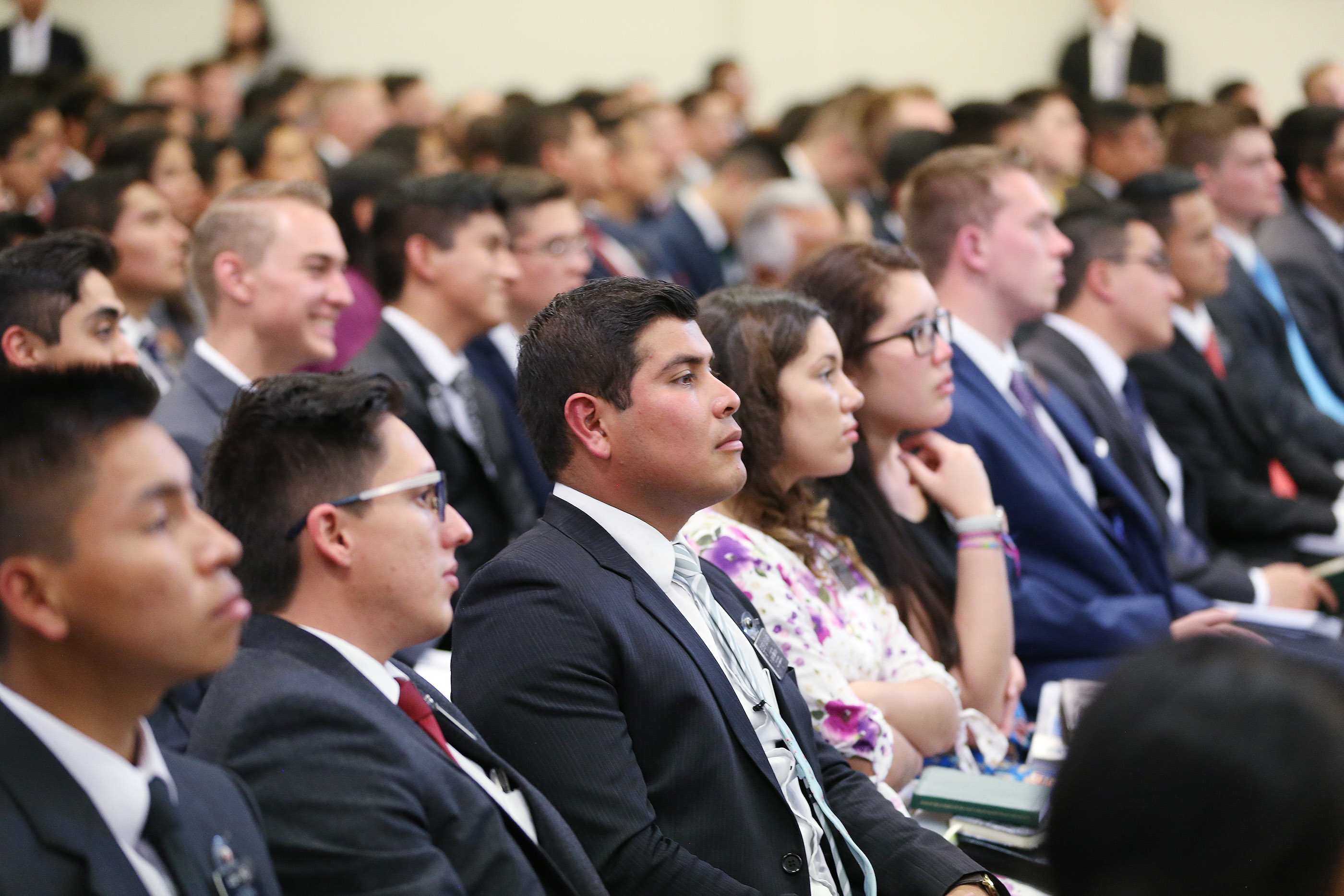 Missionaries listen during their meeting with President Russell M. Nelson of The Church of Jesus Christ of Latter-day Saints and Elder Gary E. Stevenson of the Quorum of the Twelve Apostles in Lima, Peru, on Oct. 20, 2018.
