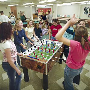 BYU students participating in the semester at Nauvoo program enjoy a game of foosball in the recreation room of the Joseph Smith Academy. Religion and traditional college courses are offered at the academy.