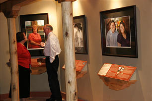 Teri and Clemence Parker enjoy a gallery of portraits.