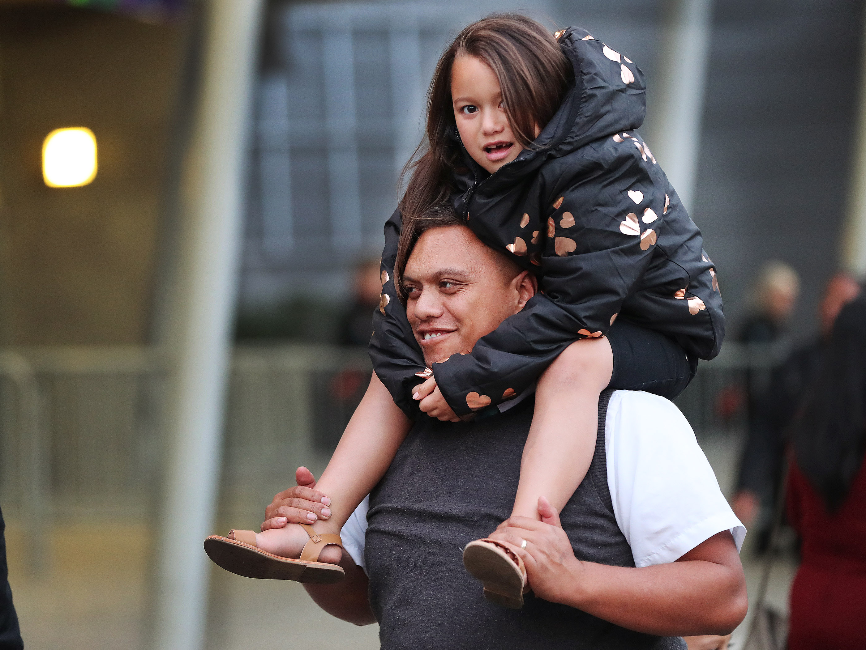 Manga Aperahama waits with his daughter Kaainga prior to a devotional with President Russell M. Nelson of The Church of Jesus Christ of Latter-day Saints in Auckland, New Zealand, on May 21, 2019.