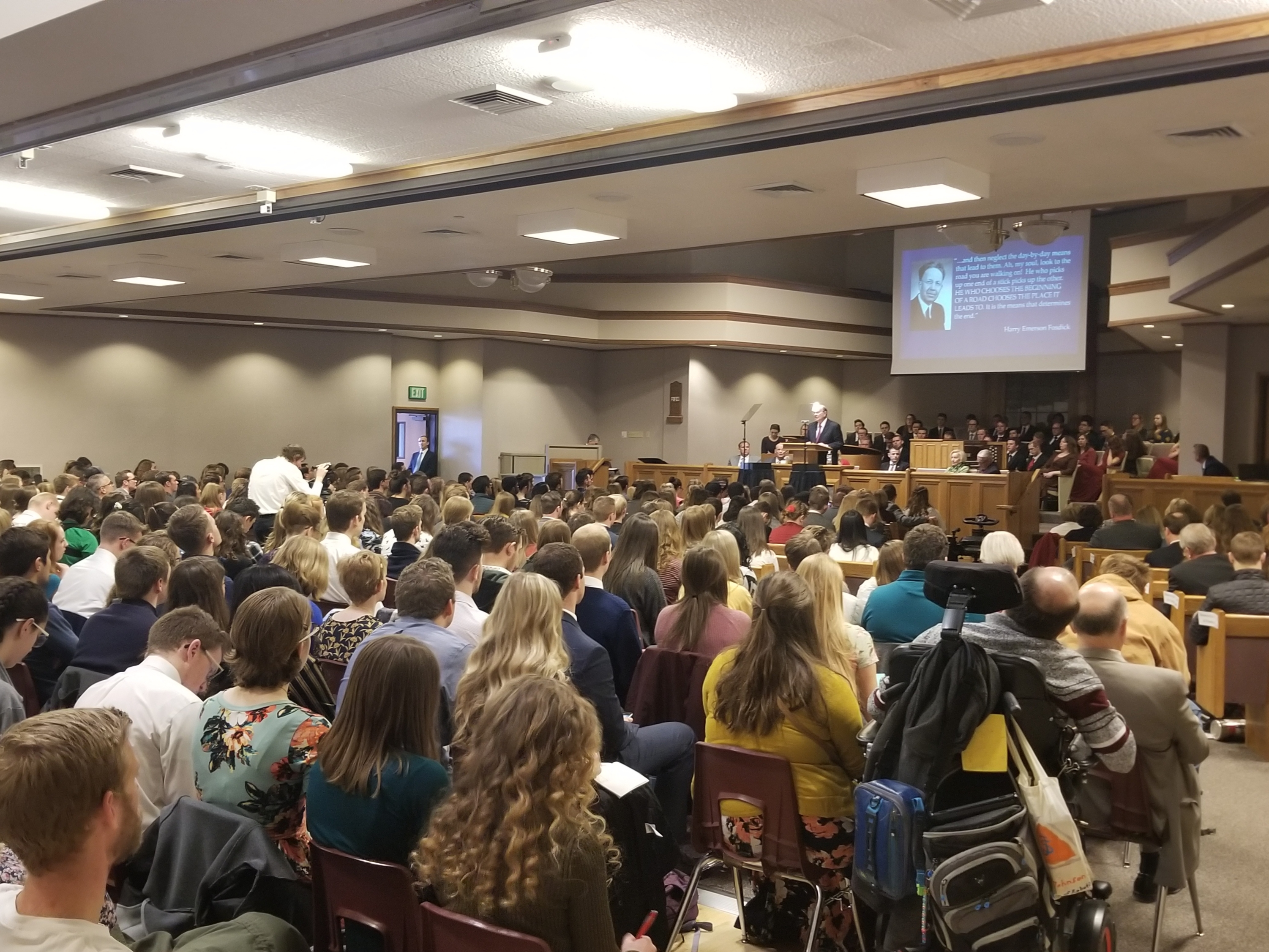 A capacity crowd in the Utah Valley Institute chapel and cultural hall listen to Elder Quentin L. Cook of the Quorum of the Twelve Apostles during a Friday, Feb. 1, 2019, devotional on the Utah Valley University campus in Orem, Utah.