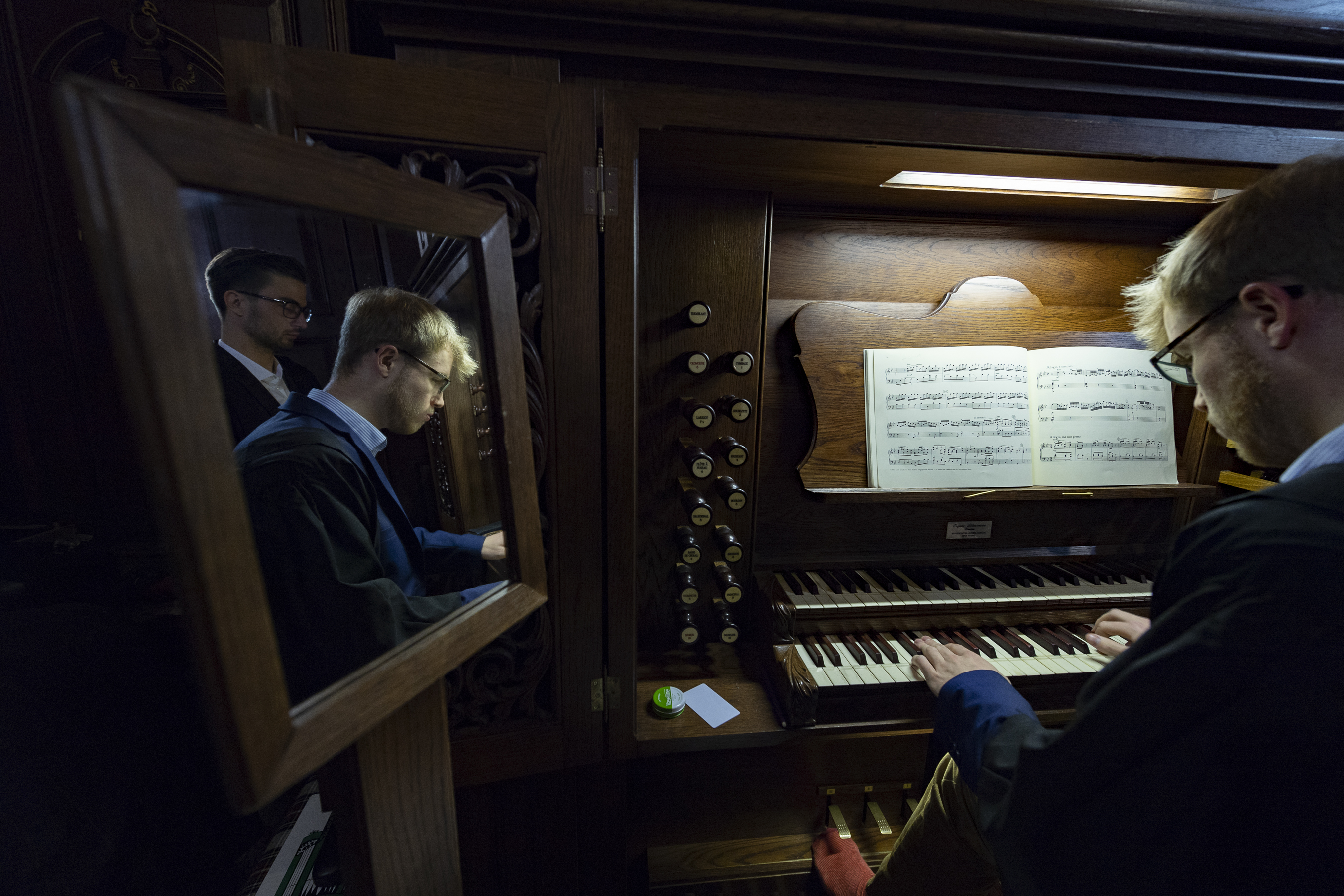 """An organist plays during the traditional Church of England """"Nine Lessons and Carols"""" service at the Pembroke College Chapel in Oxford, England, on Sunday, Nov. 25, 2018."""