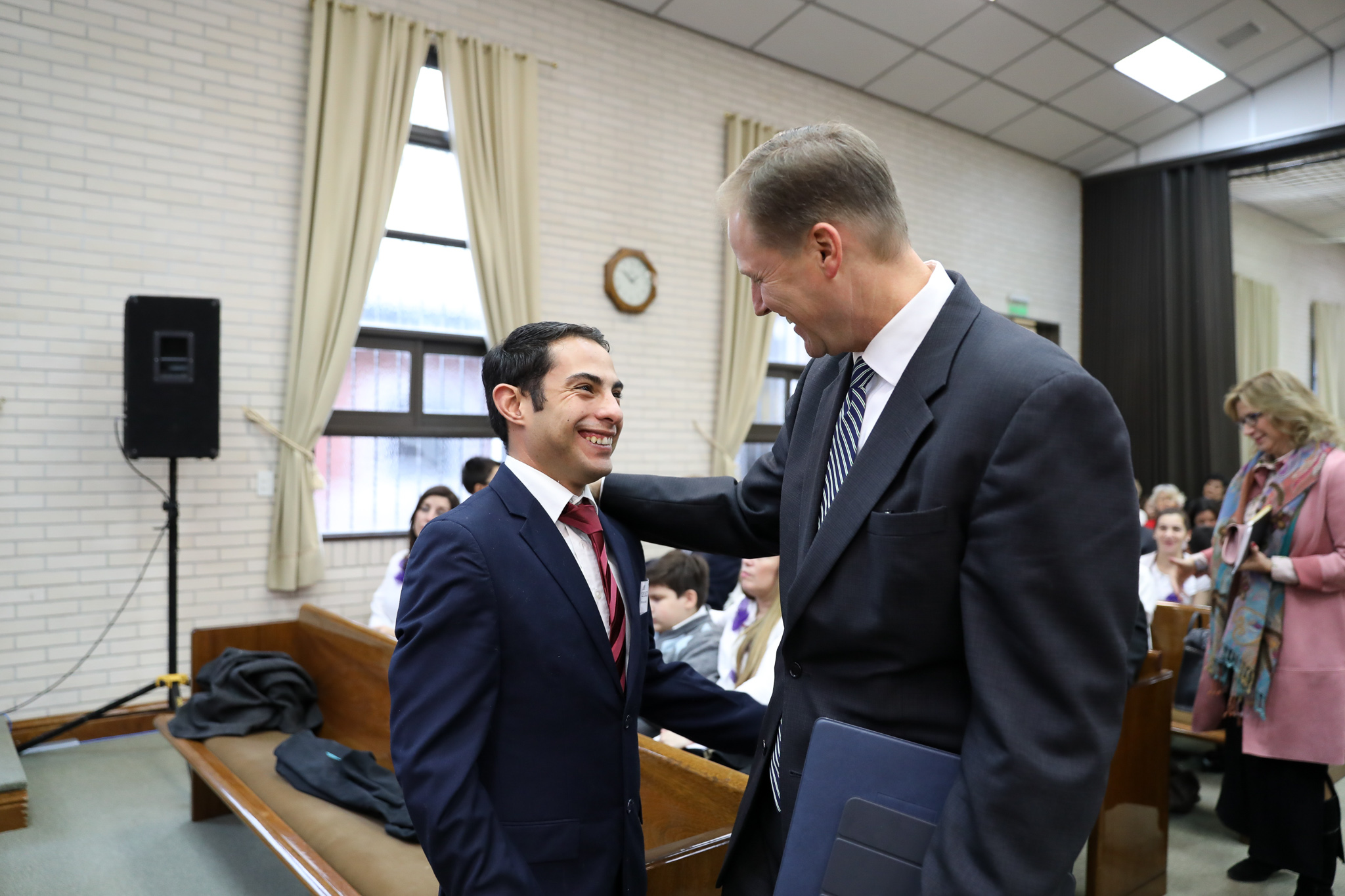 Elder Mark A. Bragg speaks with a member in the Tierra del Fuego Argentina Stake on June 2, 2019.