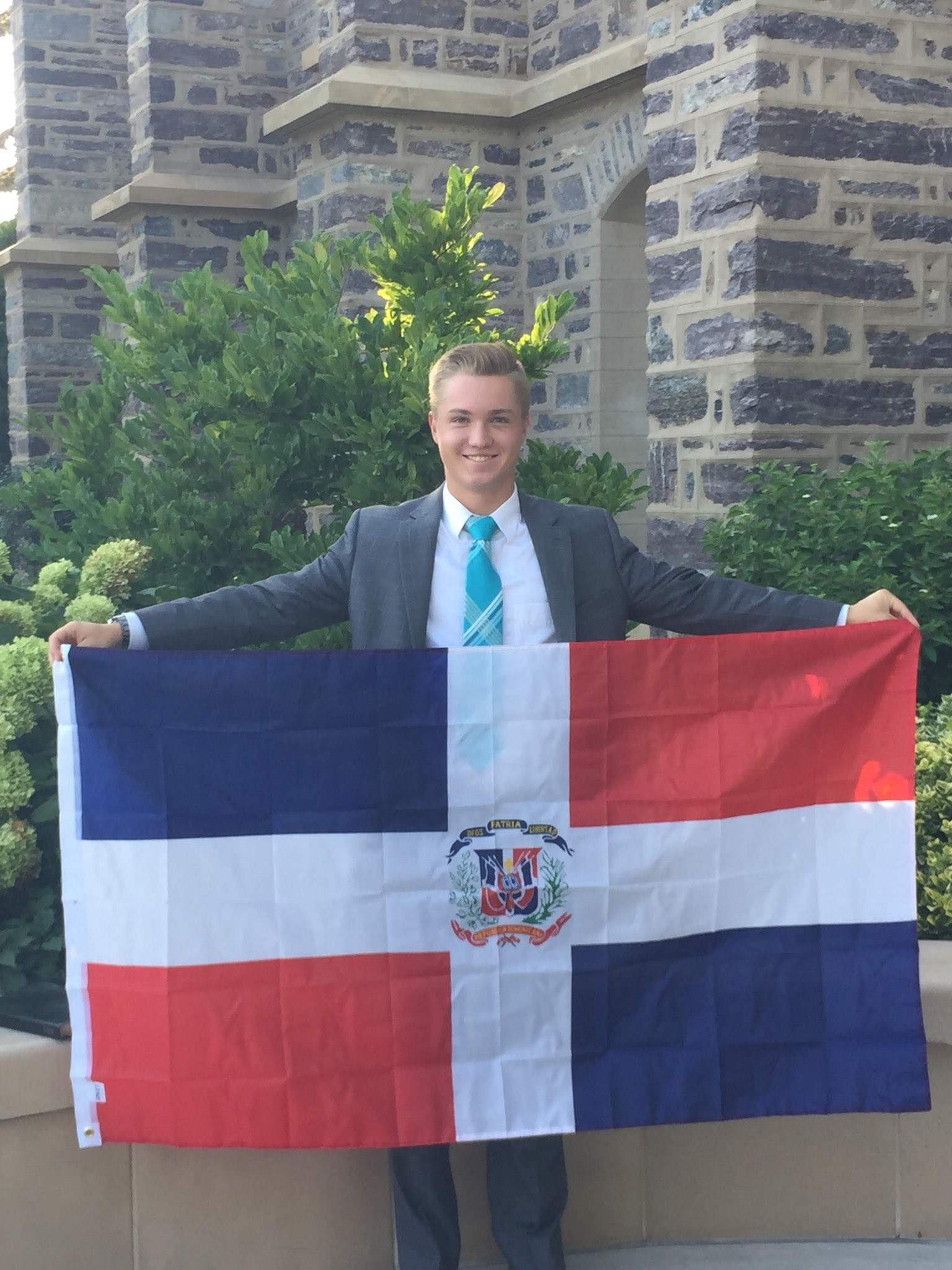 Elder Brennan Conrad, 18, of Hyde Park, Utah, holds the country flag of the Dominican Republic, having been called to serve in the Dominican Republic Santo Domingo East Mission. Elder Conrad passed away Wednesday, Feb. 20, 2019, after falling from the roof of his apartment building.