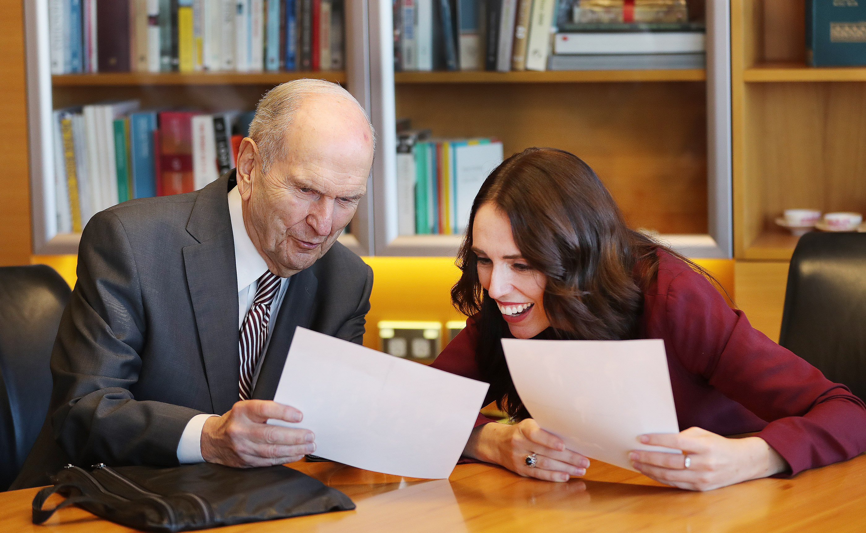 President Russell M. Nelson of The Church of Jesus Christ of Latter-day Saints gives photos of the First Presidency and Quorum of the Twelve Apostles to New Zealand Prime Minister Jacinda Ardern in Wellington, New Zealand, on Monday, May 20, 2019.