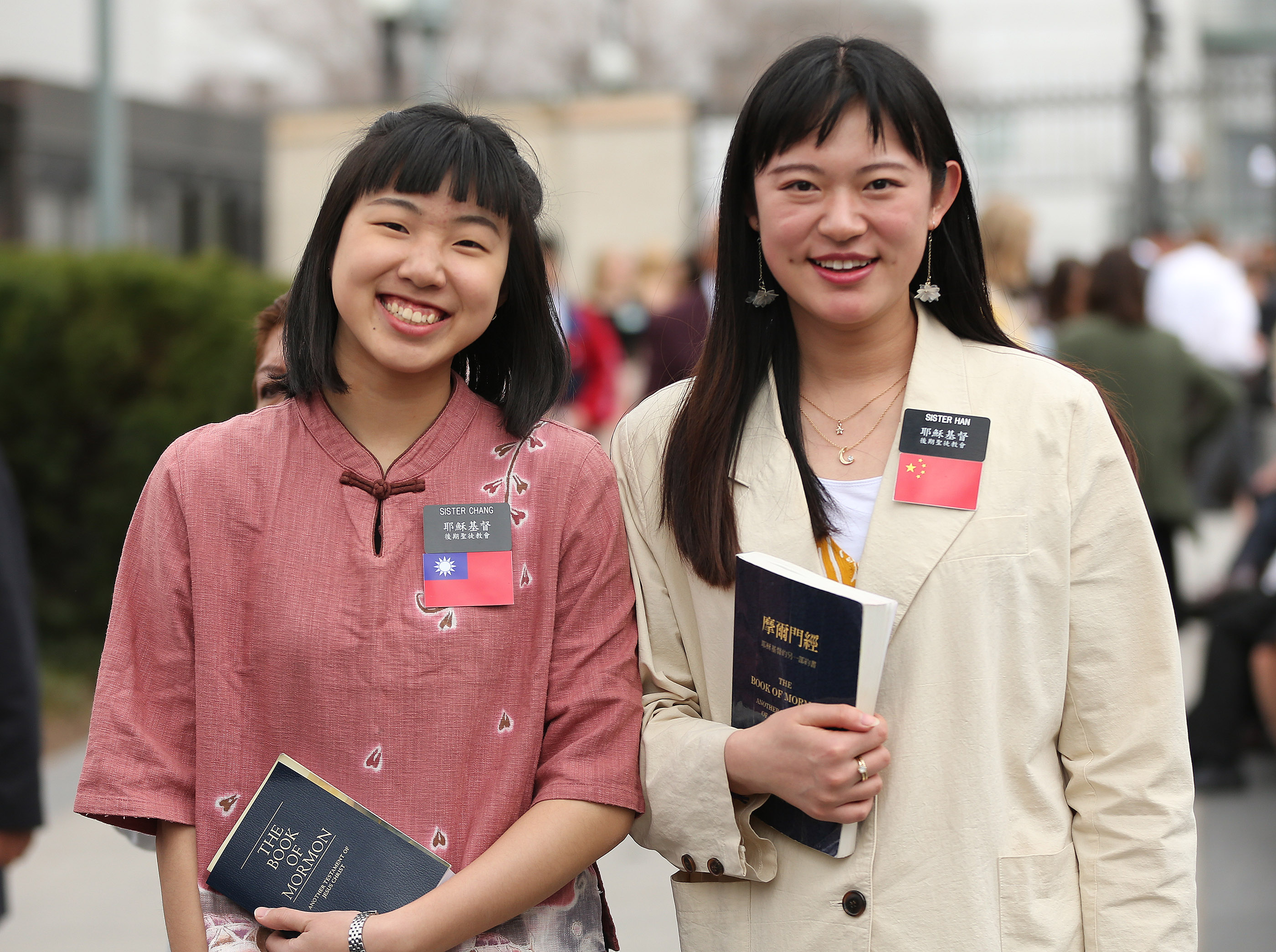 Sister Yian Chang and Sister Mehgyuan Han pause during the 189th Annual General Conference of The Church of Jesus Christ of Latter-day Saints in Salt Lake City on Sunday, April 7, 2019.