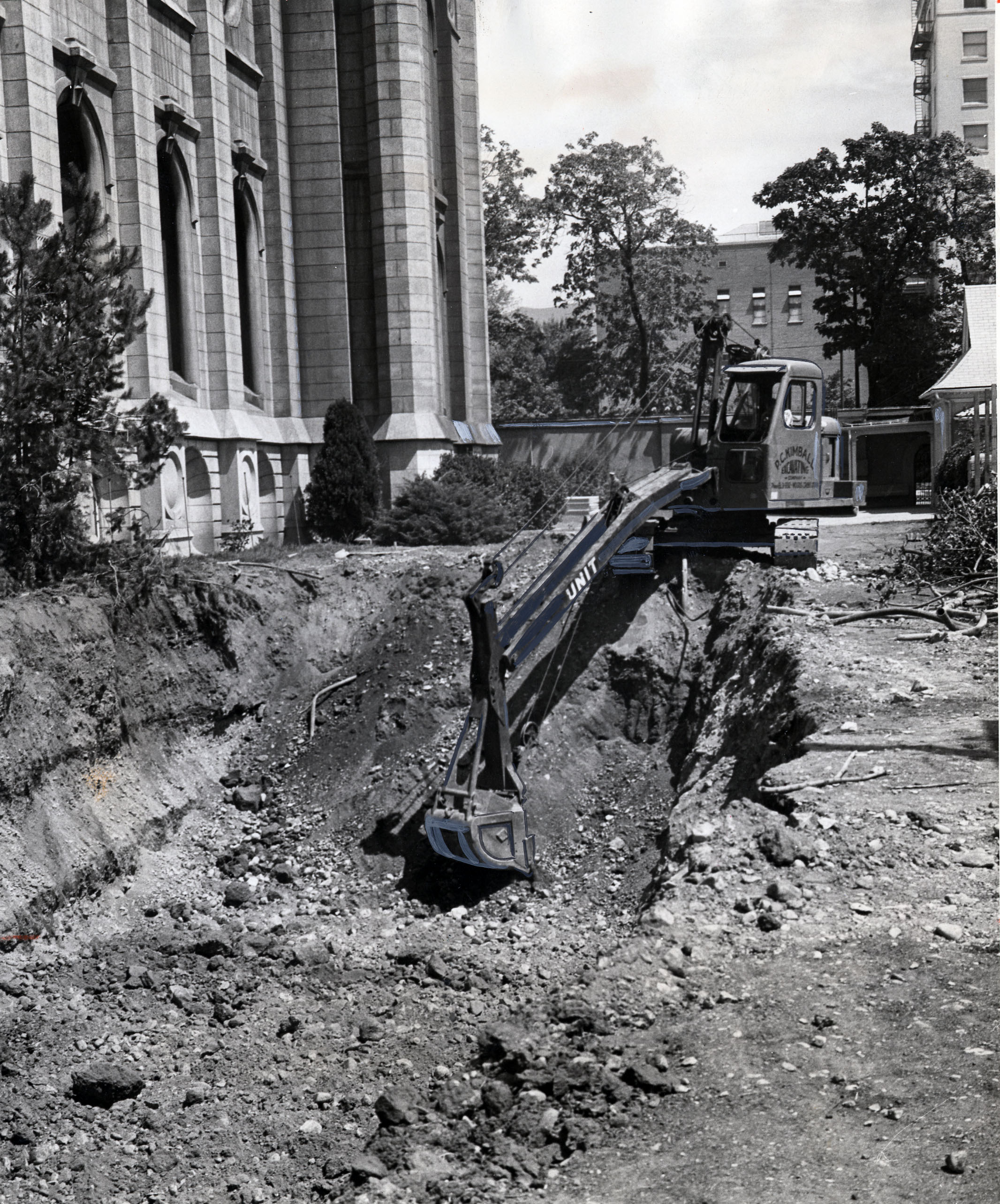 Scoop shovel makes dirt fly on south side of Salt Lake Temple as new renovation work gets underway. Aug. 13, 1962 W. Claudell Johnson, Deseret News