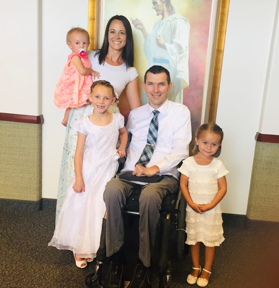 Jarom and Leslie Hlebasko pose with their three daughters at the baptism of their oldest daughter, Jaden, in 2014.