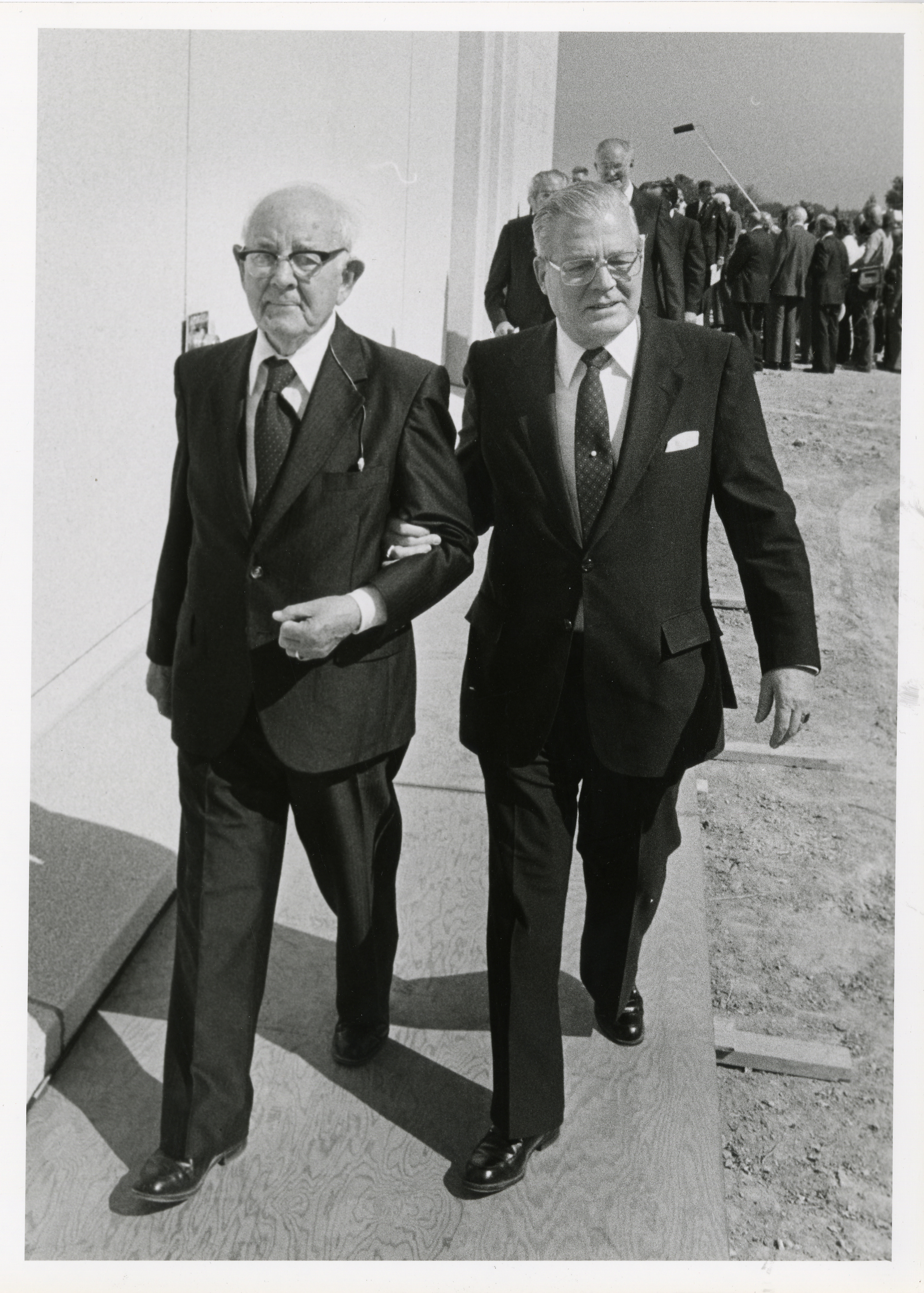 Spencer W. Kimball, president of the Church is being escorted by his secretary D. Arthur Haycock for the dedication of the Jordan River Utah Temple in 1981.