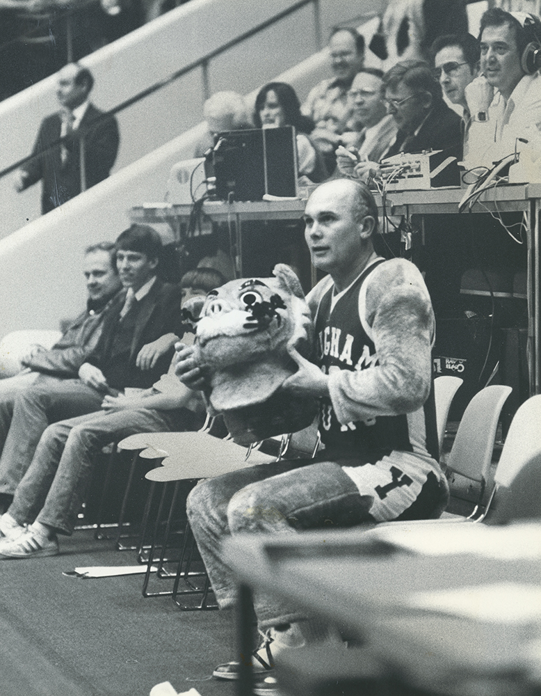 "Pres. Dallin H. Oaks delights basketball fans as BYU mascot ""Cosmo the Cougar"" during a 1978 basketball game."