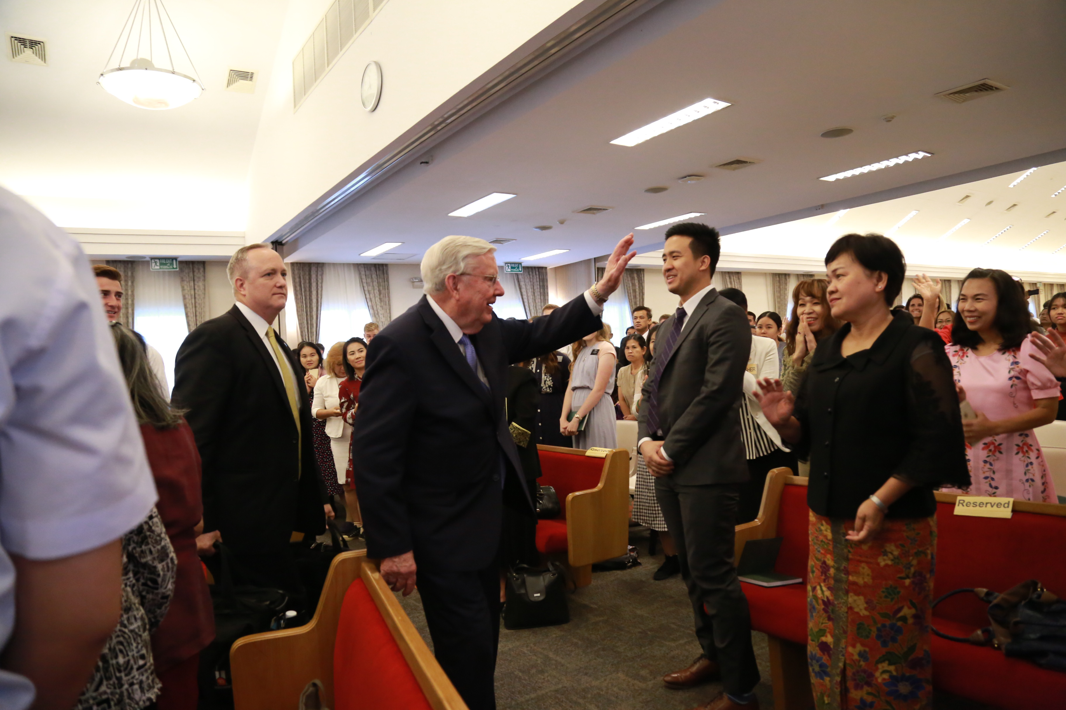 President M. Russell Ballard waves to members after speaking at a stake conference in the Thailand Bangkok North Stake in May 2019.