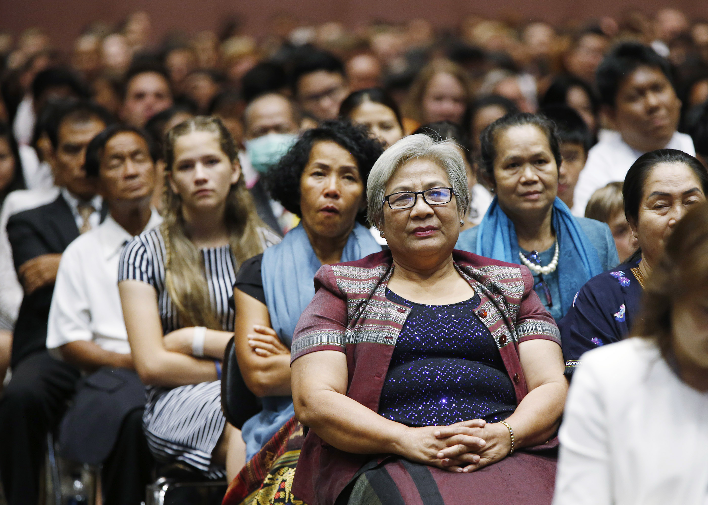 Attendees listen during a devotional with Russell M. Nelson, President of The Church of Jesus Christ of Latter-day Saints, in Bangkok, Thailand, on Friday, April 20, 2018.