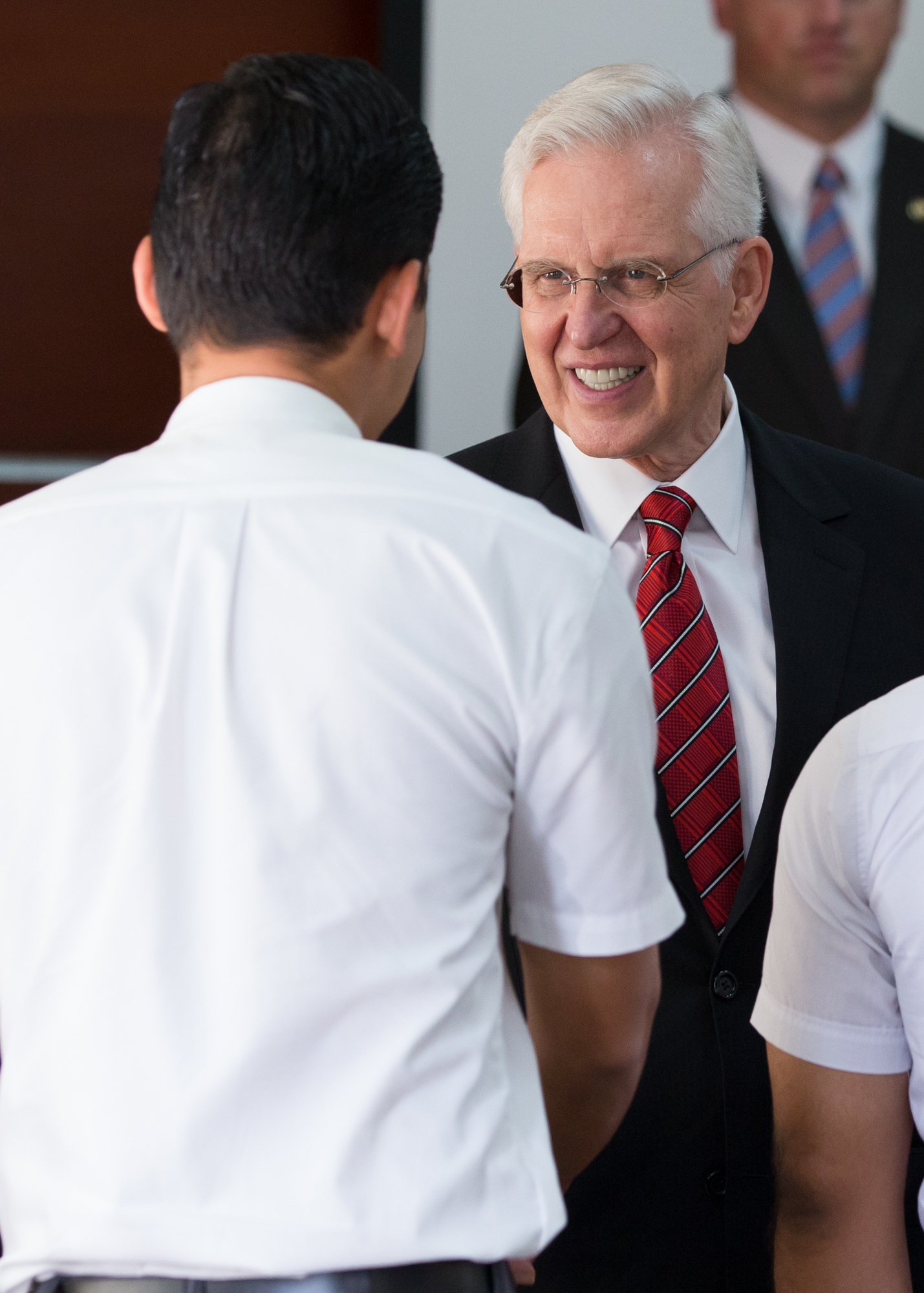 Elder D. Todd Christofferson shakes hands with a missionary at a gathering with the Dominican Republic Santo Domingo West Mission on Nov. 10, 2018.